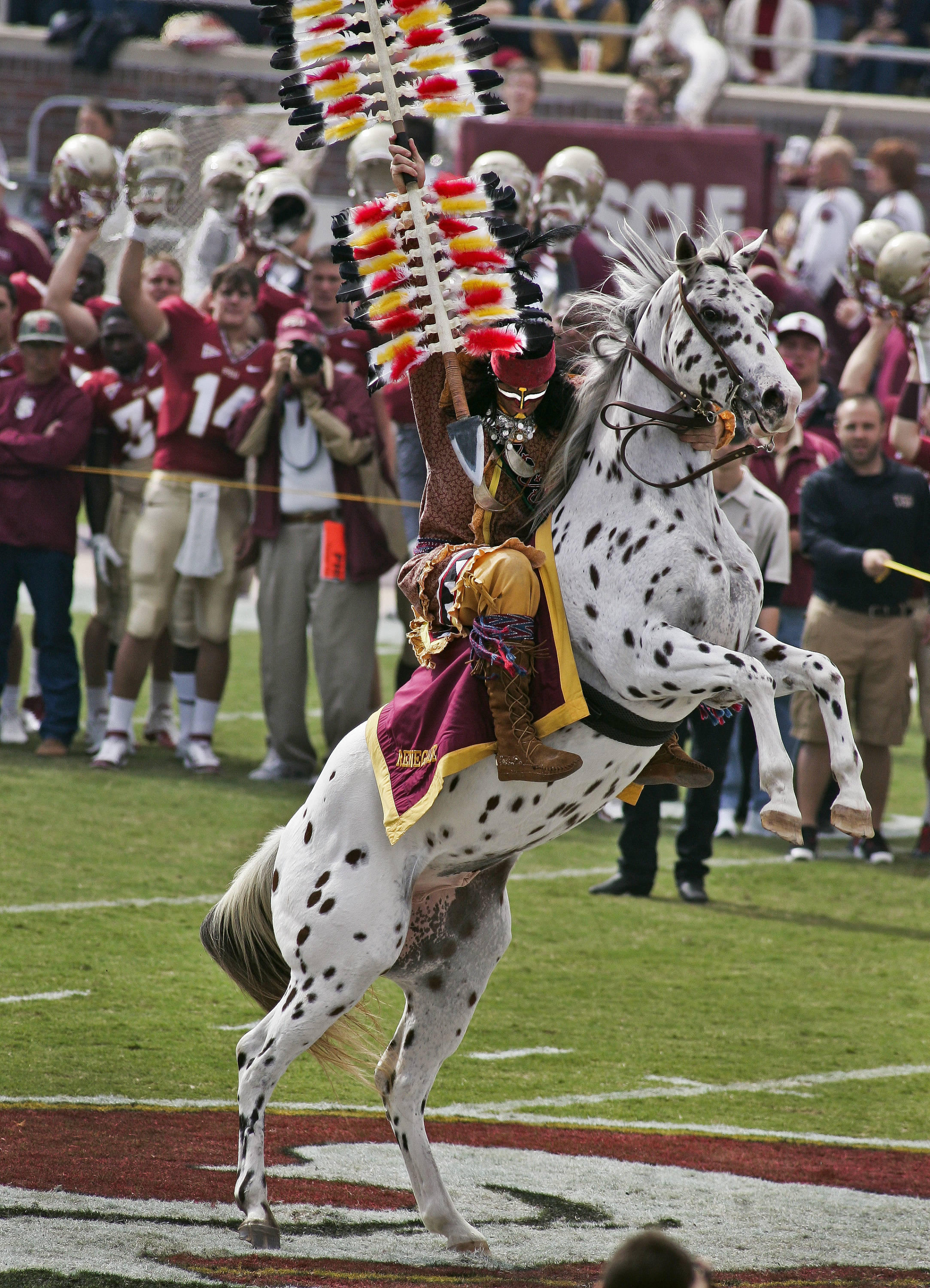 Florida State mascot Osceola, riding Renegade, plants his spear at the 50-yard line before a game against North Carolina State. (AP Photo/Phil Sears)