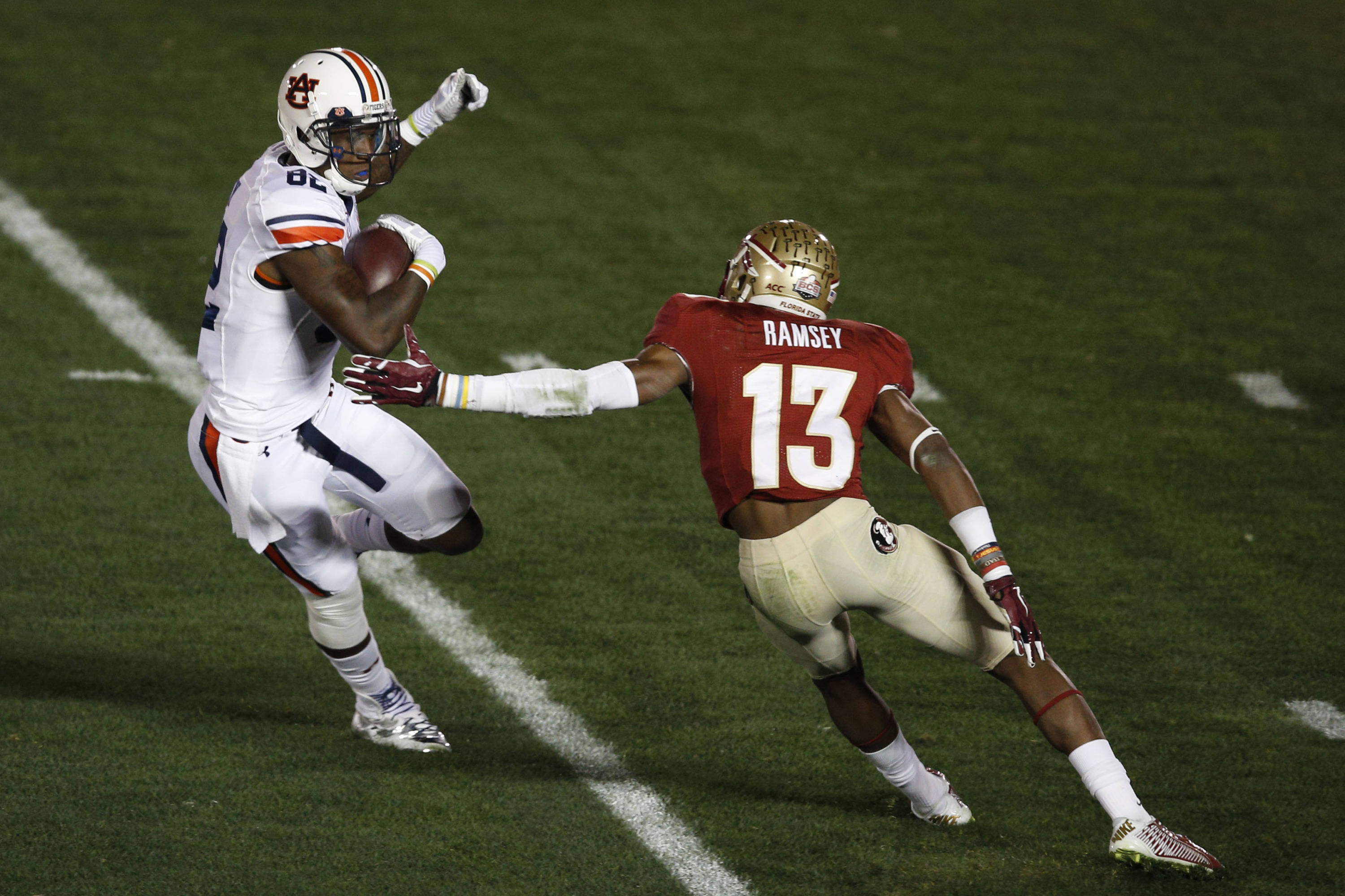 Jan 6, 2014; Pasadena, CA, USA; Auburn Tigers wide receiver Melvin Ray (82) runs the football past Florida State Seminoles defensive back Jalen Ramsey (13) for a touchdown during the first half of the 2014 BCS National Championship game at the Rose Bowl.  Mandatory Credit: Kelvin Kuo-USA TODAY Sports
