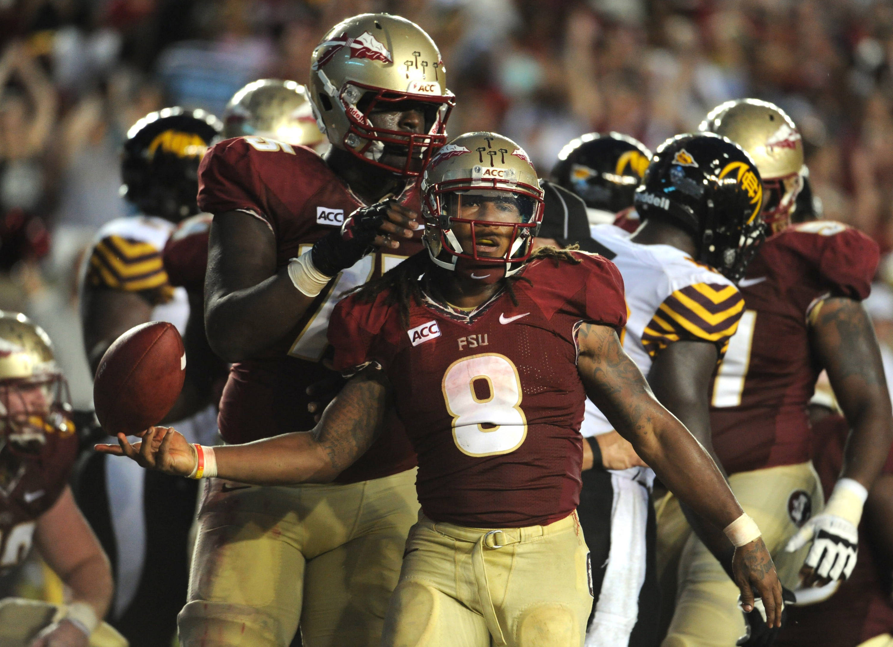 Florida State Seminoles running back Devonta Freeman (8) celebrates a touchdown run with offensive lineman Cameron Erving (75) during the second half of the game against the Bethune-Cookman Wildcats. (Melina Vastola-USA TODAY Sports)