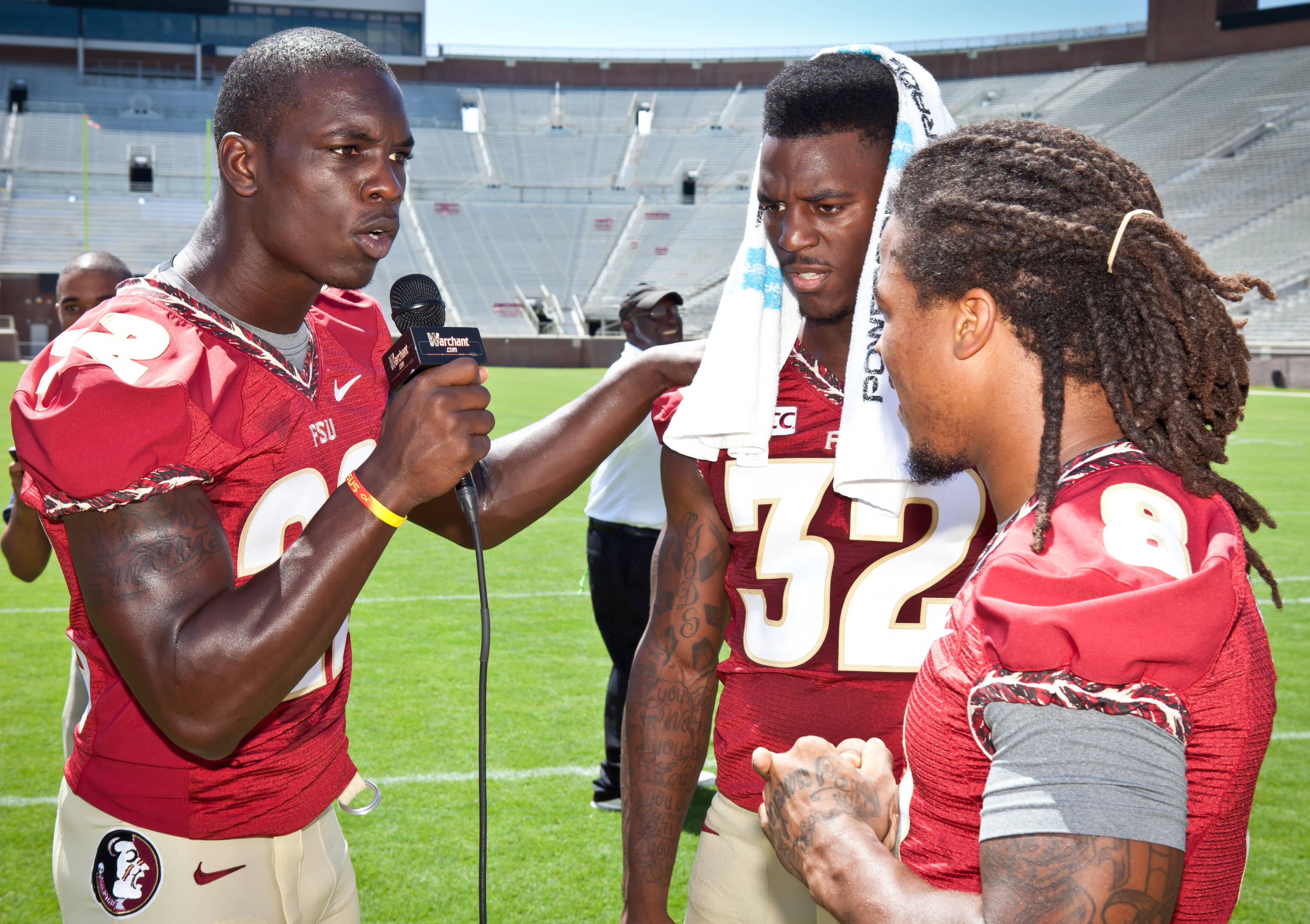 Telvin Smith takes his turn behind the microphone  interviewing running backs James Wilder Jr. and Devonta Freeman.