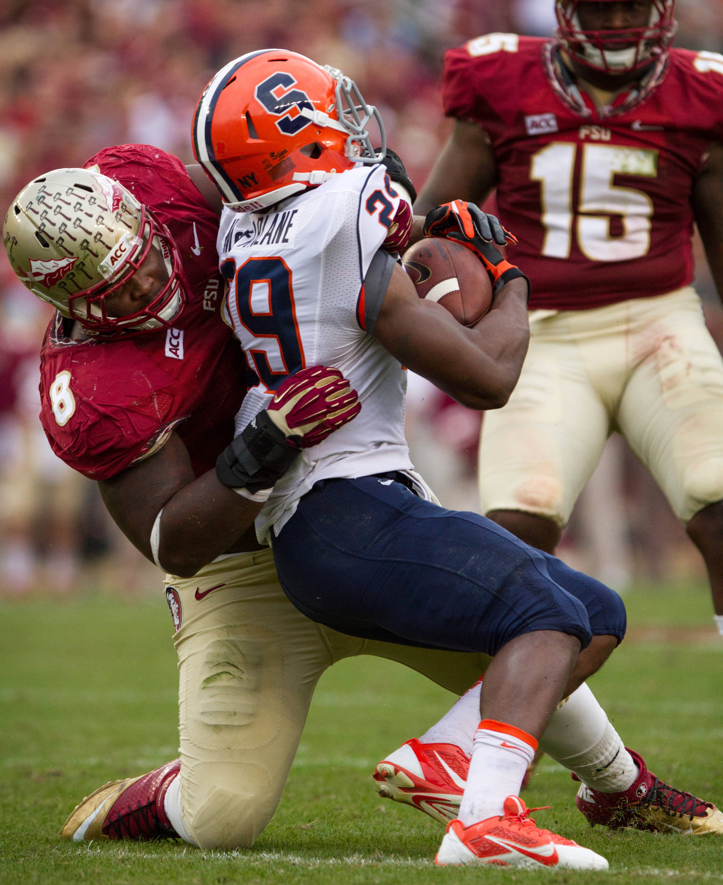 Timmy Jernigan (8) tackles a Syracuse ball carrier during FSU Football's 59-3 win over Syracuse on Saturday, November 16, 2013 in Tallahassee, Fla. Photo by Mike Schwarz.