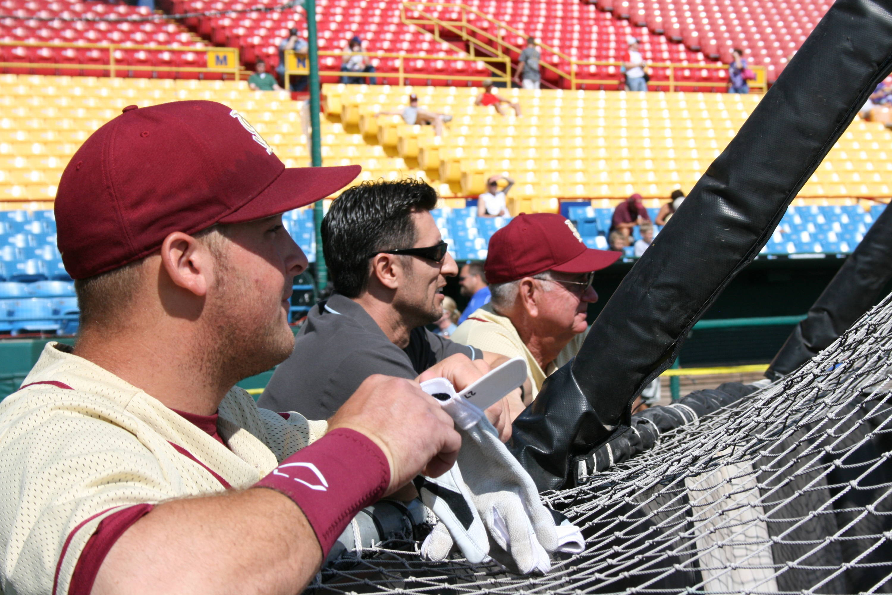 Stuart Tapley, ESPN's Nomar Garciaparra and head coach Mike Martin watching batting practice on Friday inside Rosenblatt