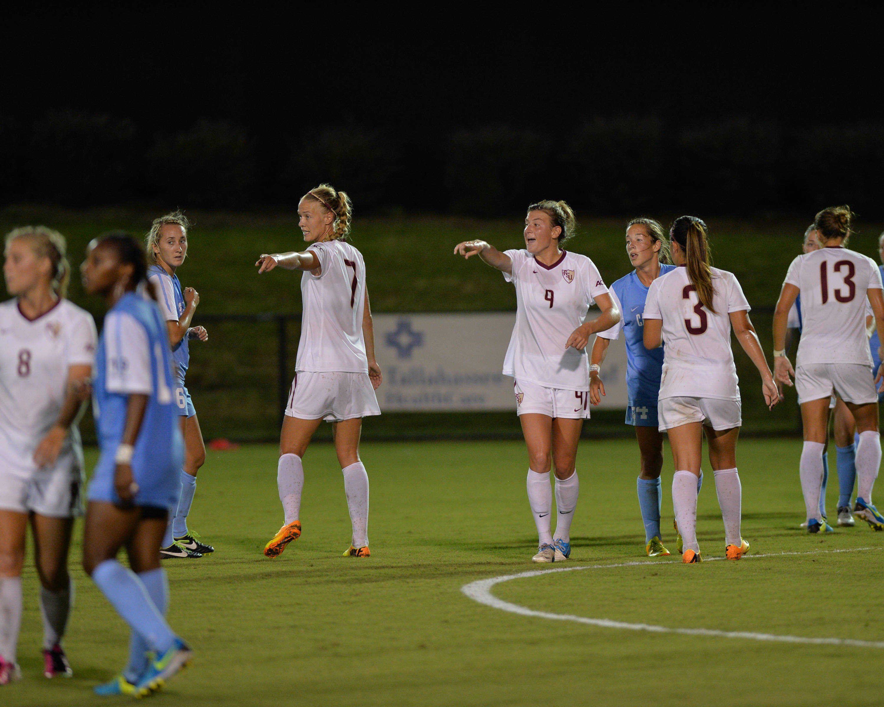 The Seminoles set things up prior to a UNC free kick.
