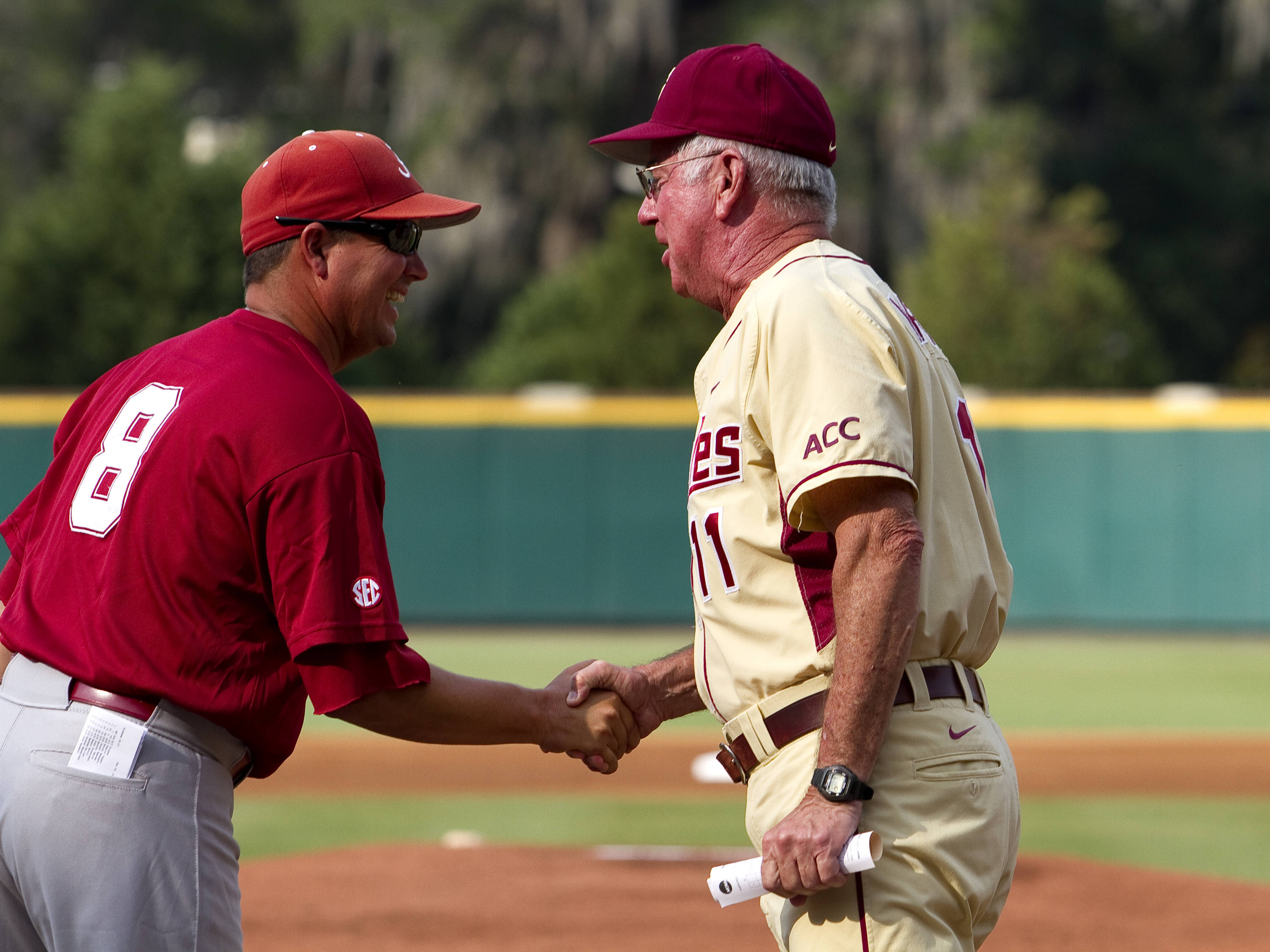 Head coaches Mitch Gaspard (8), Alabama and Mike Martin (11) FSU enjoy a moment before the beginning of their game.