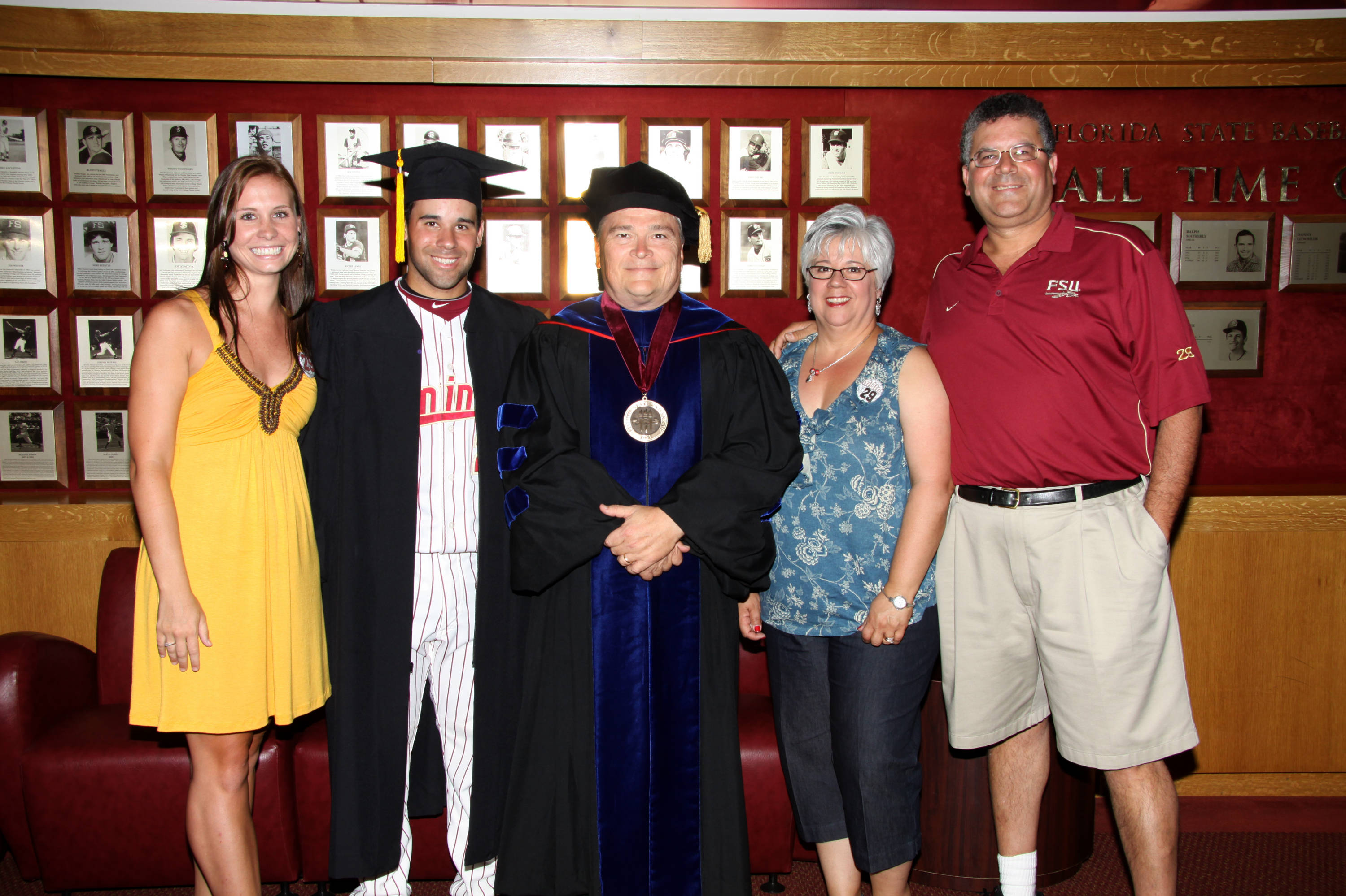2011 Spring Graduation Ceremony held at Dick Howser Stadium to honor the graduating baseball seniors. Rafael Lopez (29) with family and President Barron
