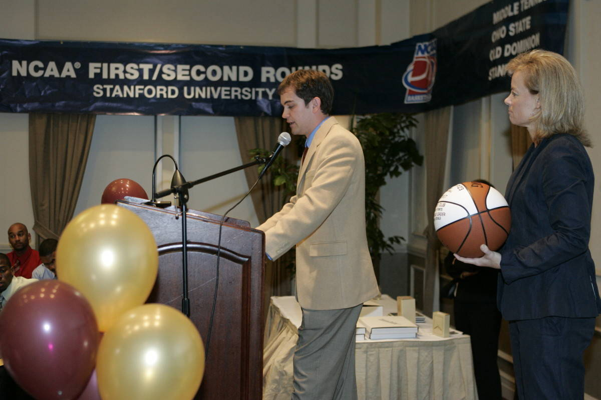 Voice of the FSU Women's Basketball team Ryan Pensy, Master of Ceremonies and Coach Sue.
