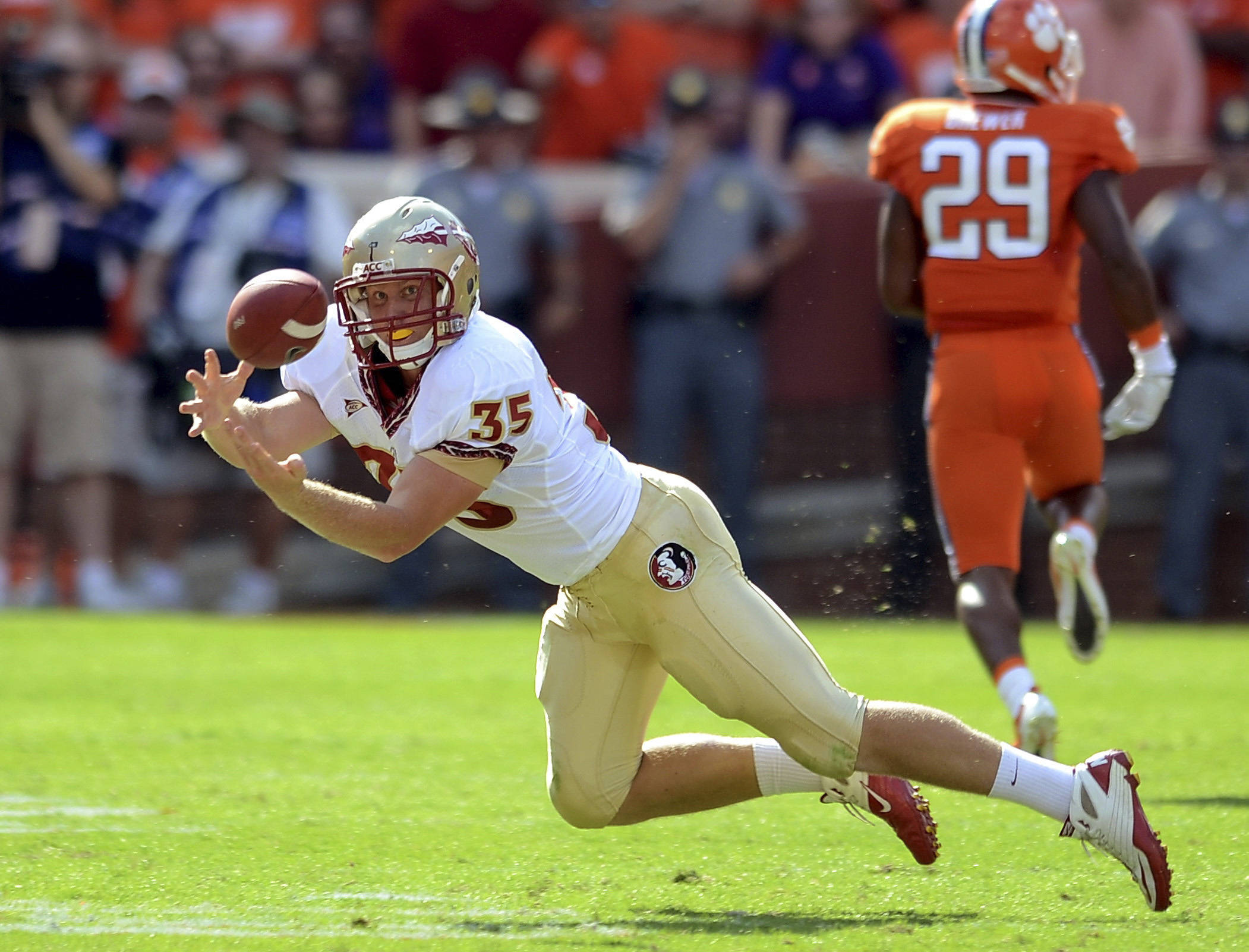 Florida State tight end Nick O'Leary (35) stretches out for a reception in the first quarter of an NCAA college football game against Clemson, Saturday Sept. 24, 2011 at Memorial Stadium in Clemson, S.C.  (AP Photo/ Richard Shiro)