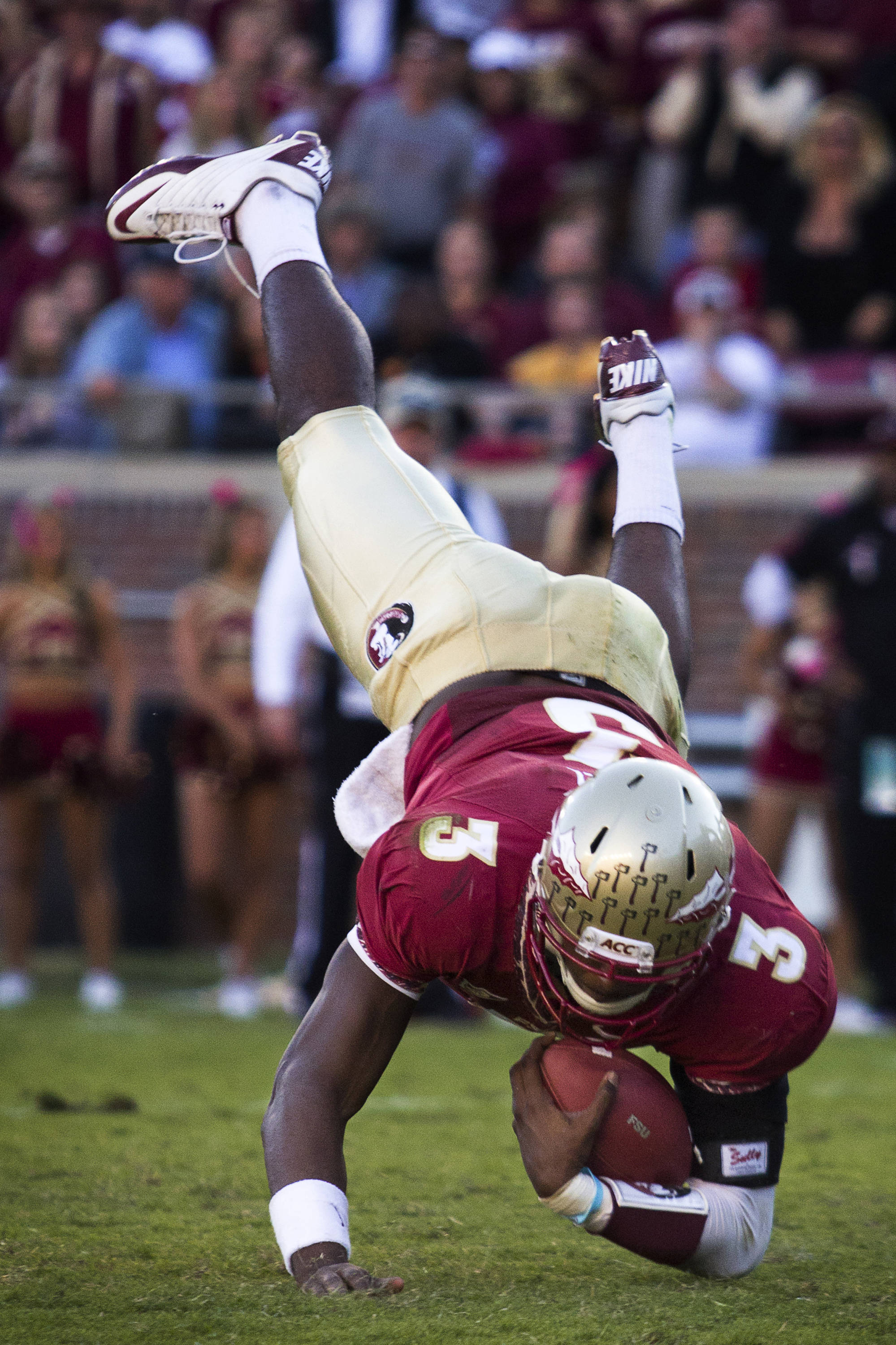 EJ Manuel (3) slams in to the ground after taking a hit during the football game against Maryland in Tallahassee, Florida on October 22, 2011.