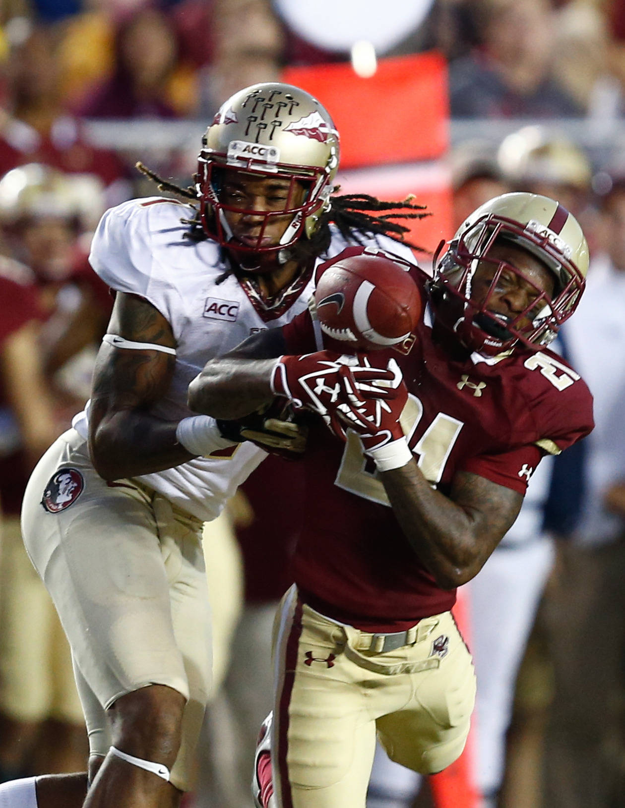 Sep 28, 2013; Boston, MA, USA; Boston College Eagles defensive back Manuel Asprilla (21) deflects the ball away from Florida State Seminoles wide receiver Kelvin Benjamin (1) during the second half at Alumni Stadium. Mandatory Credit: Mark L. Baer-USA TODAY Sports
