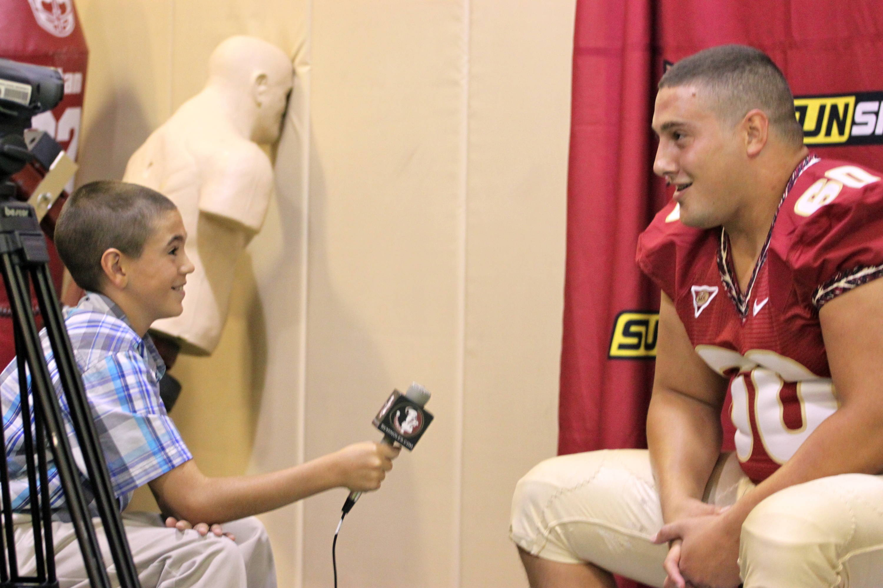 Ryan McMahon and Jr. Nole reporter Blaine Thomas at football media day.