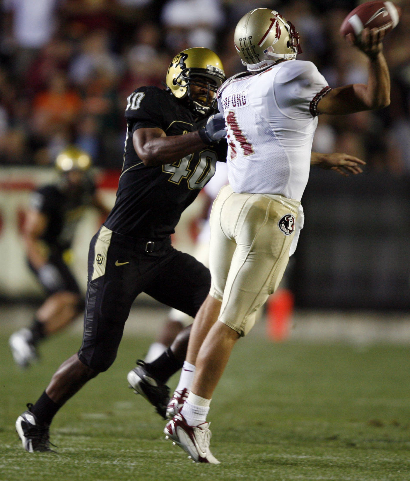 Colorado linebacker Brad Jones, left, reaches out to tackle Florida State quarterback Drew Weatherford as he tries to throw a pass in the first quarter. (AP Photo/David Zalubowski)