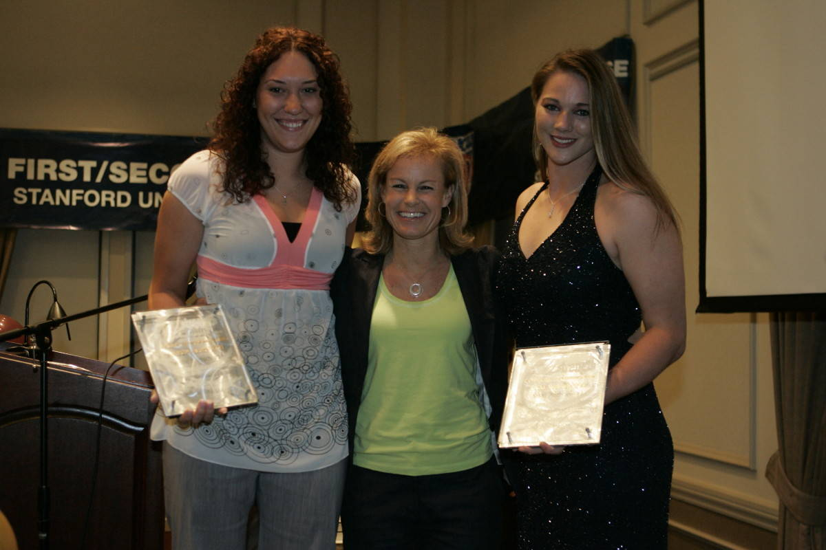 Christie Lautsch and Nikki Anthony with Coach Sue. Lautsch and Anthony were recognized for their service to the community.