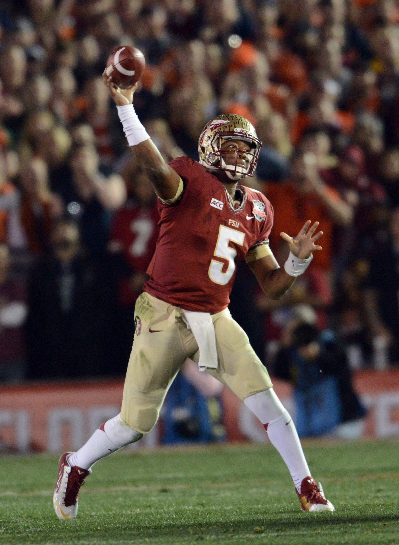 Jan 6, 2014; Pasadena, CA, USA; Florida State Seminoles quarterback Jameis Winston (5) throws a pass against the Auburn Tigers during the first half of the 2014 BCS National Championship game at the Rose Bowl.  Mandatory Credit: Jayne Kamin-Oncea-USA TODAY Sports