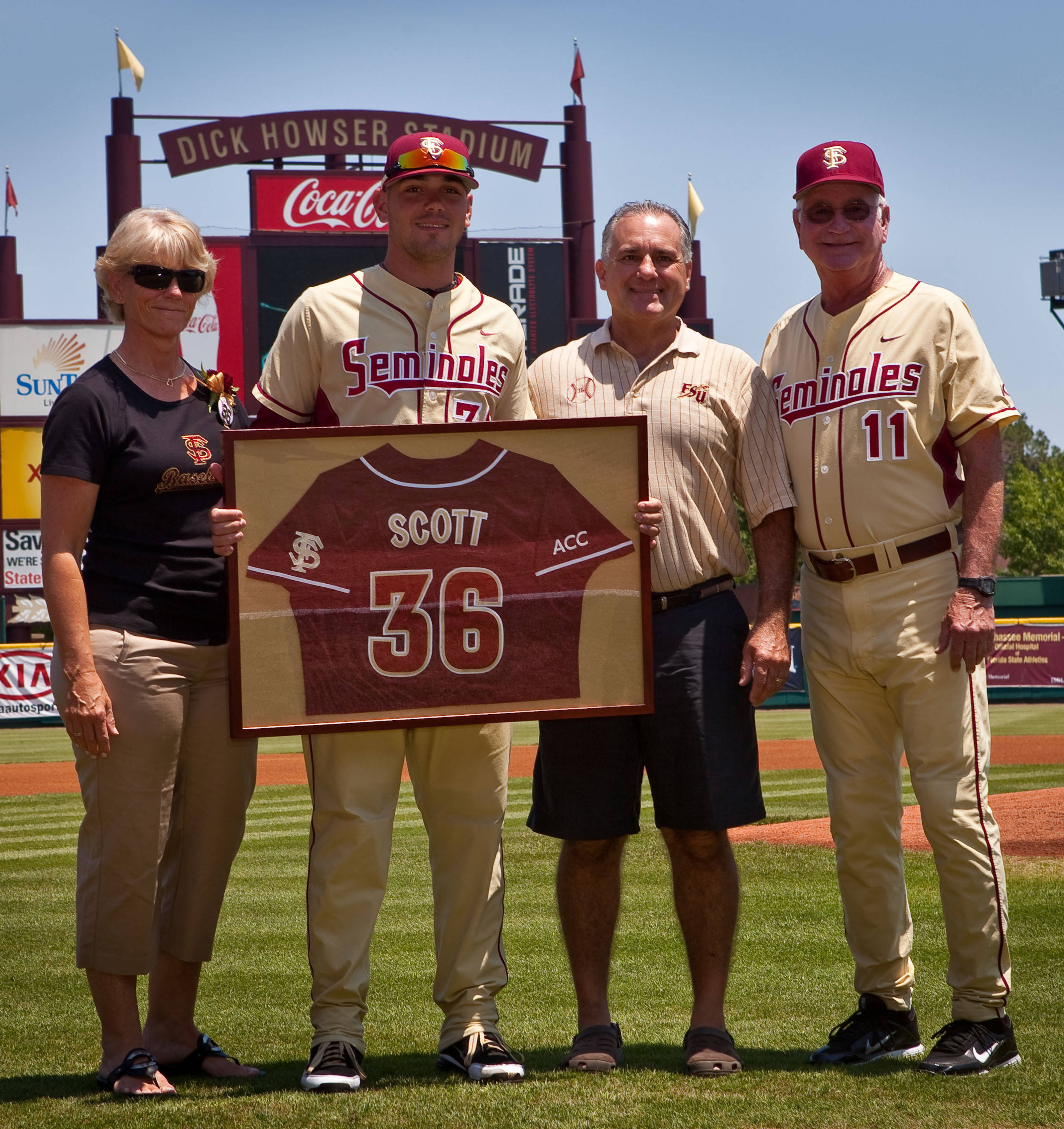 FSU senior pitcher Robby Scott with his parents and Mike Martin.