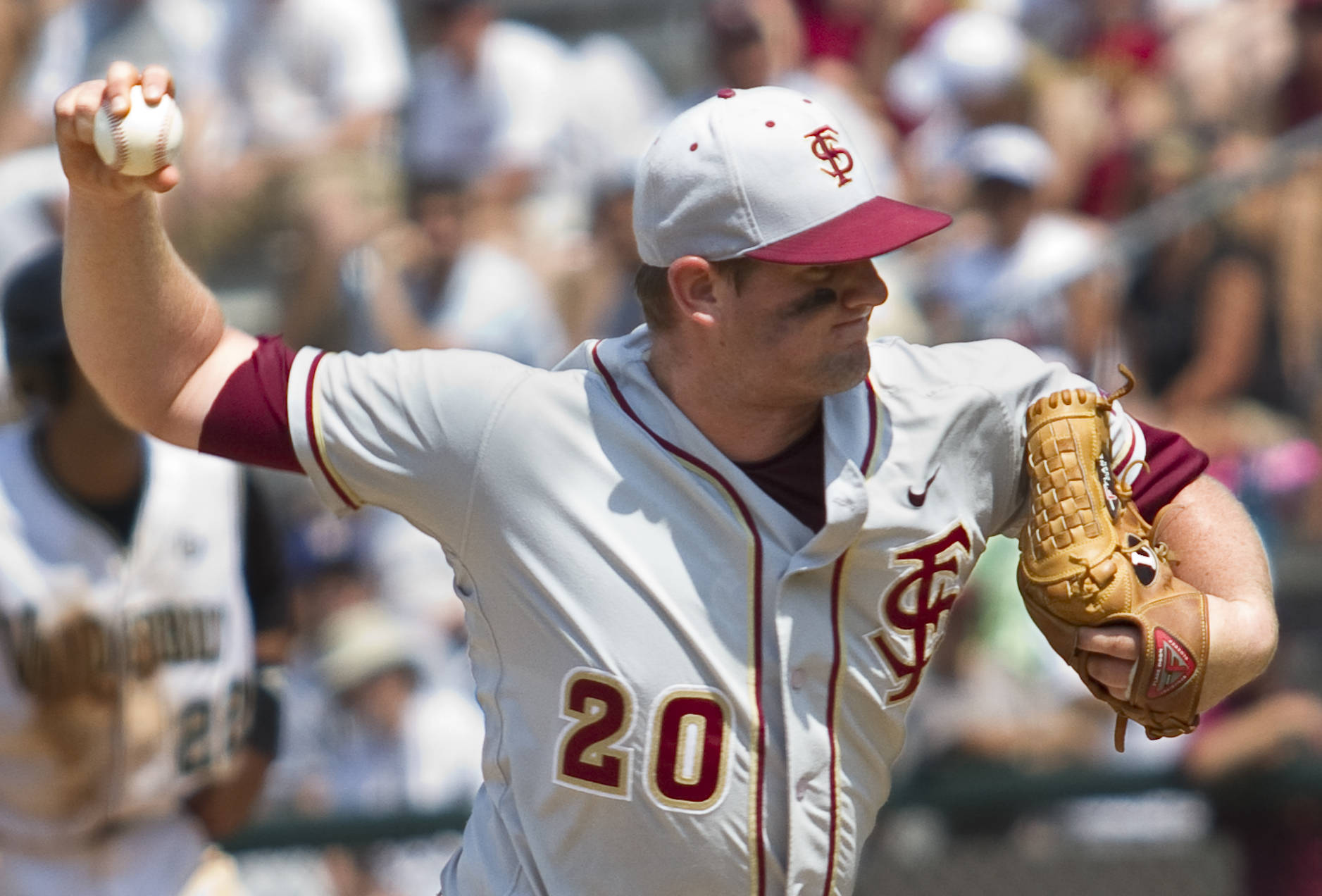 Daniel Bennett (20) pitches for FSU in the eighth inning.