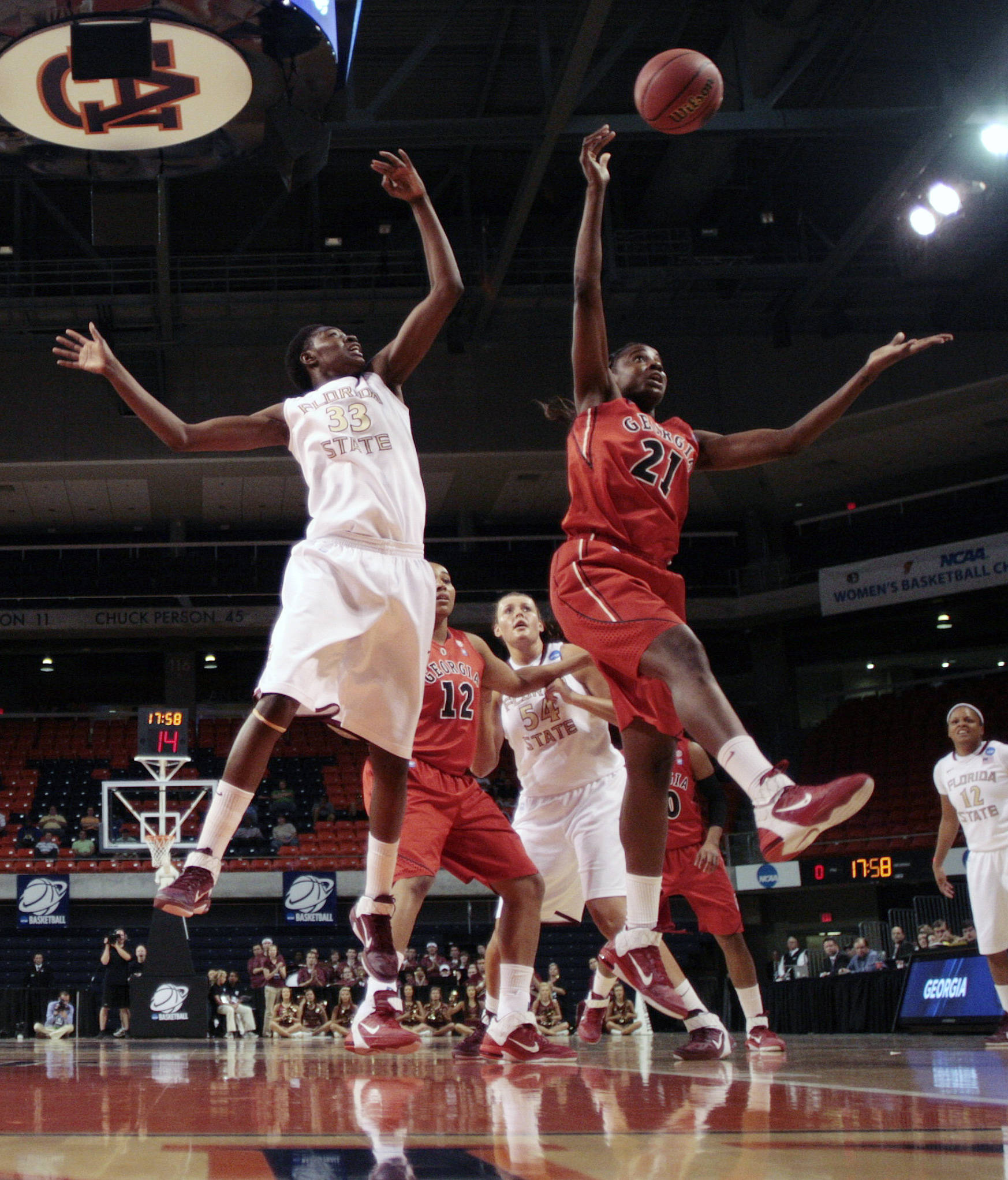 Florida State's Natasha Howard (33) battles Georgia's Porsha Phillips (21) for a rebound in the first half of a second-round NCAA women's college basketball tournament game at Auburn Arena in Auburn, Ala., Tuesday, March 22, 2011. (AP Photo/Dave Martin)