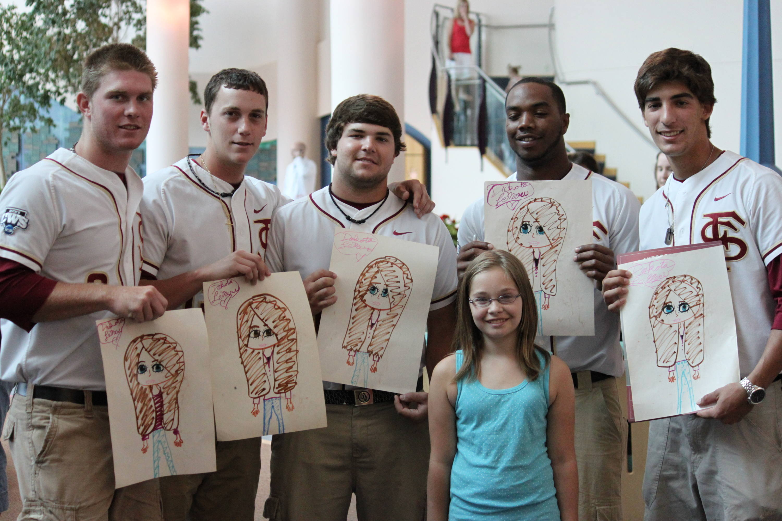 Stephen McGee, Robert Benincasa, Scott Sitz, Taiwan Easterling and Justin Gonzalez show off their art work during their visit to the Children's Hospital.