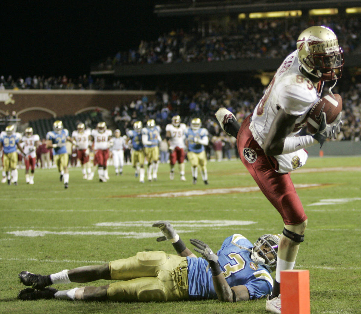 Florida State wide receiver Greg Carr, right, hauls in a 30-yard touchdown pass over UCLA cornerback Rodney Van (3) during the fourth quarter of the Emerald Bowl college football game in San Francisco, Wednesday, Dec. 27, 2006.(AP Photo/Marcio Jose Sanchez)