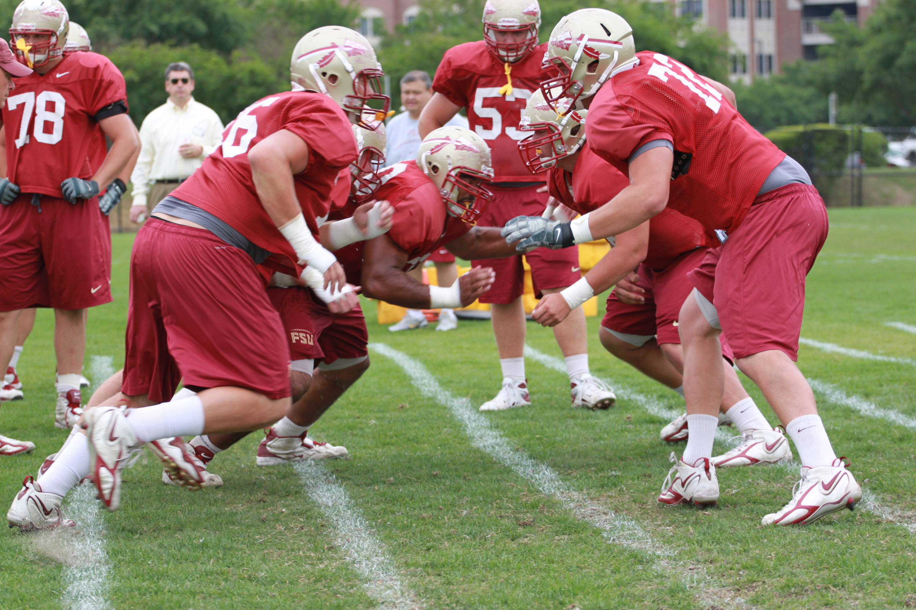 The linemen showing their brute force and mentality.