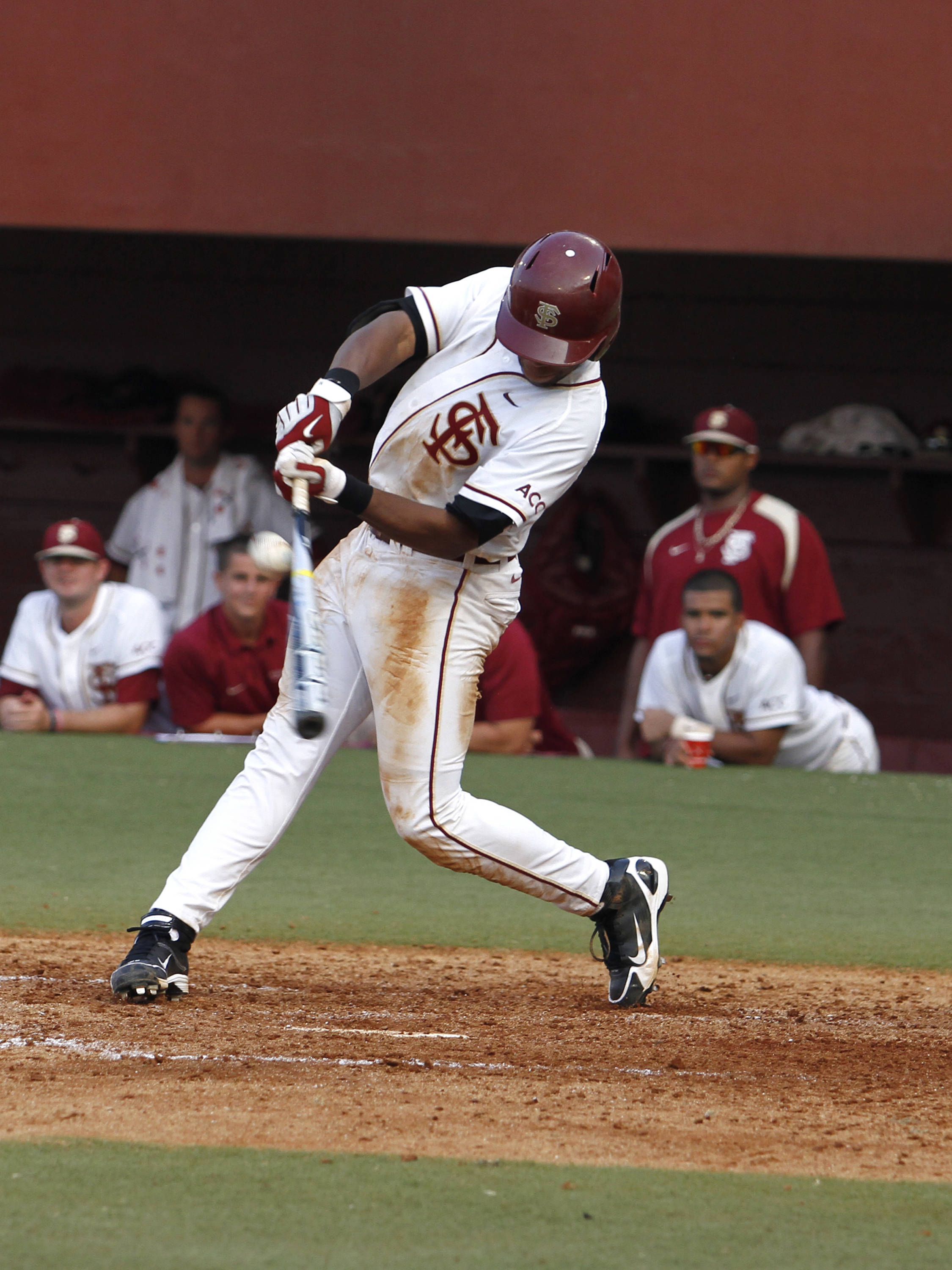 Sherman Johnson (32) fights of an inside pitch for a two run single in the fifth inning.