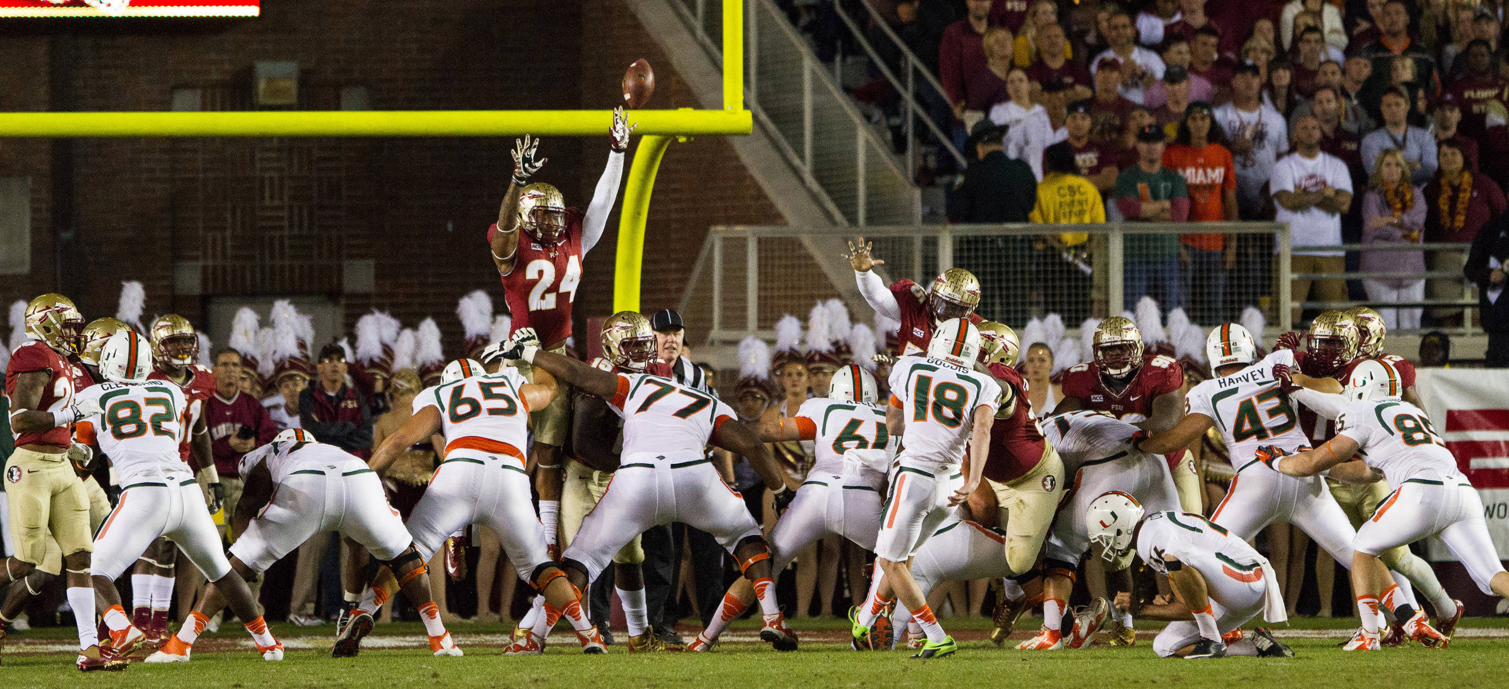 Terrance Smith (24) attempts to block an extra point during FSU football's 41-14 win over Miami on Saturday, November 2, 2013 in Tallahassee, Fla. Photo by Michael Schwarz.