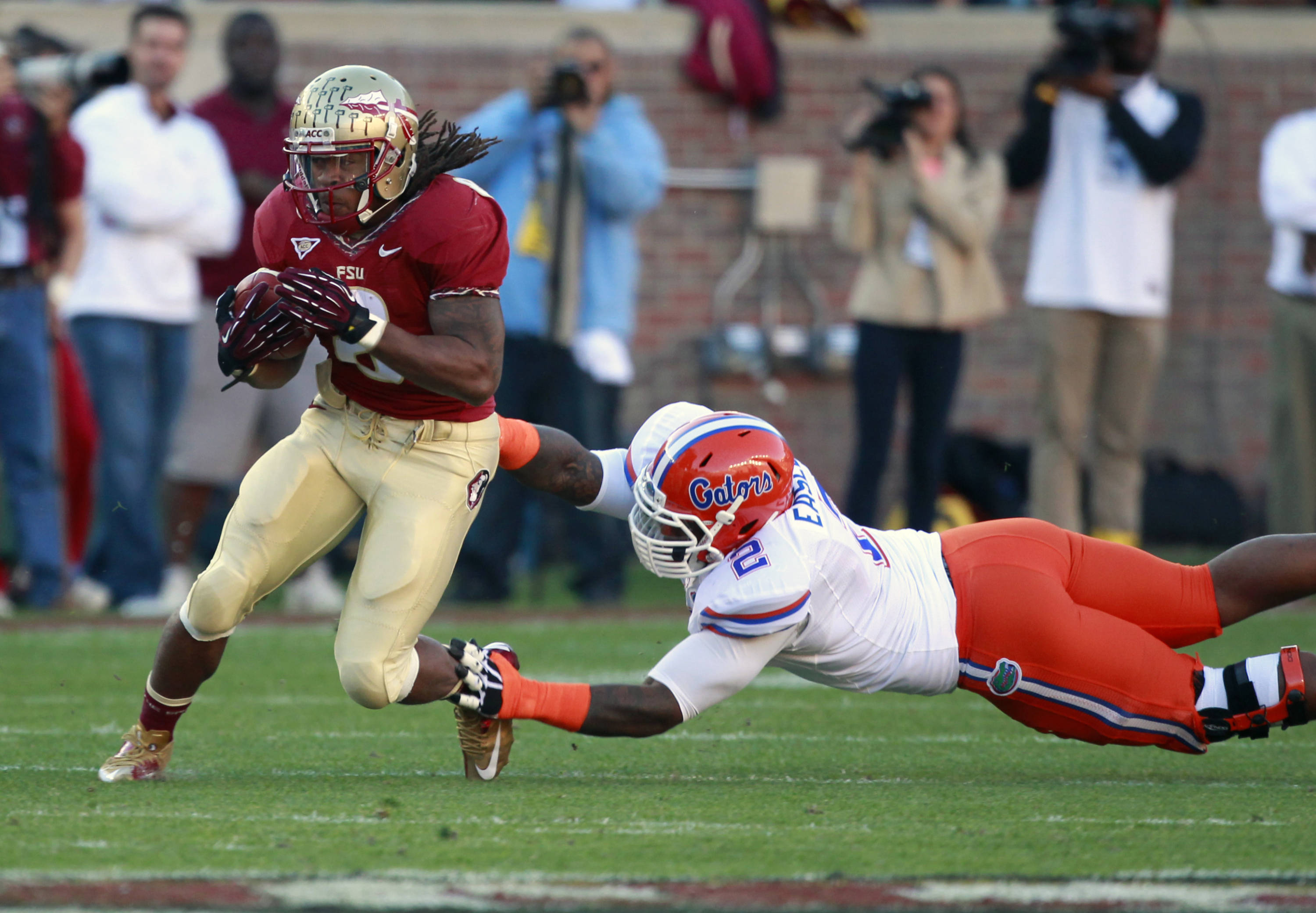 Florida State running back Devonta Freeman runs past Florida defensive lineman Dominique Easley (2). (AP Photo/John Raoux)