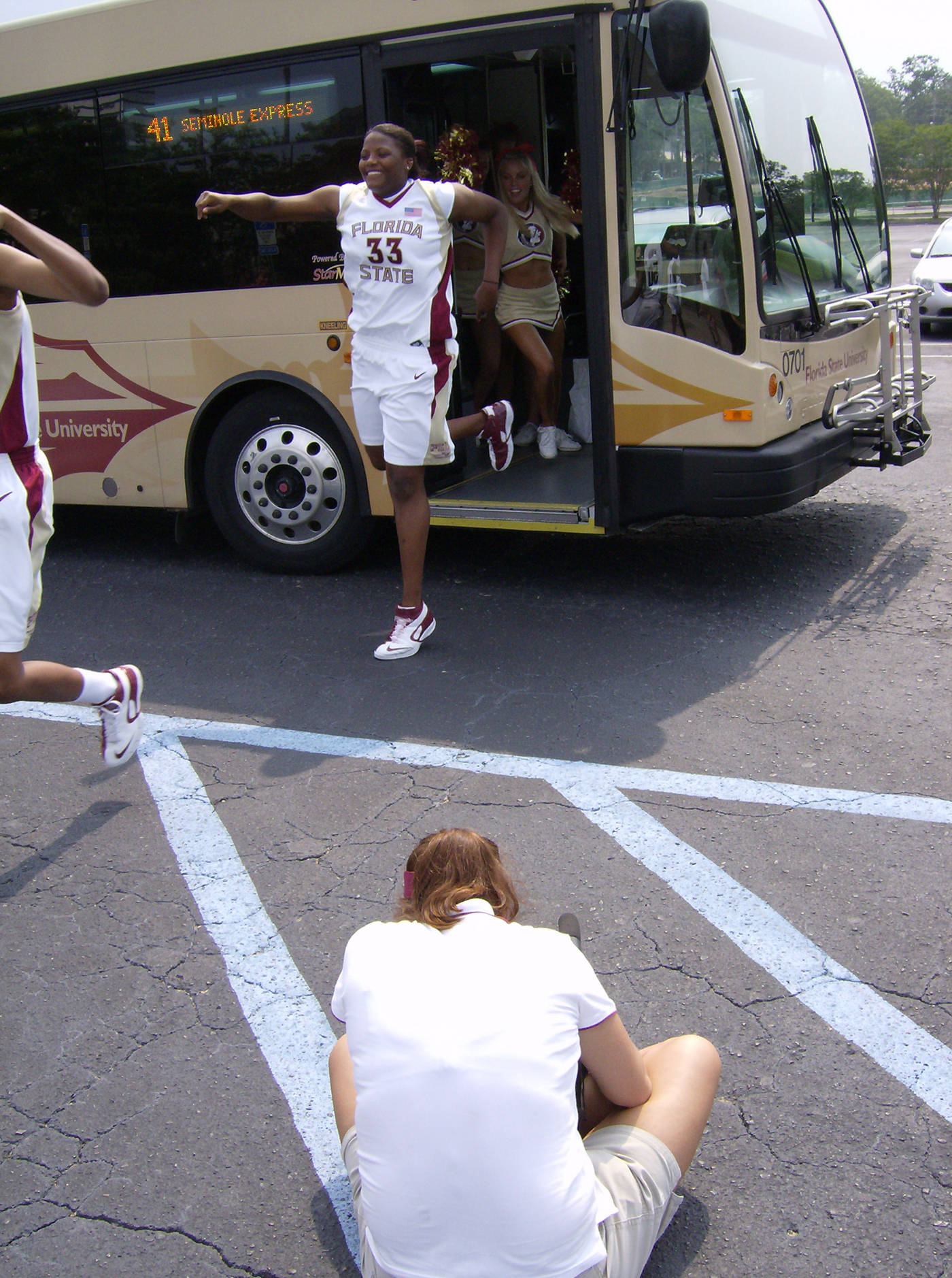 Britany Miller coming off the bus