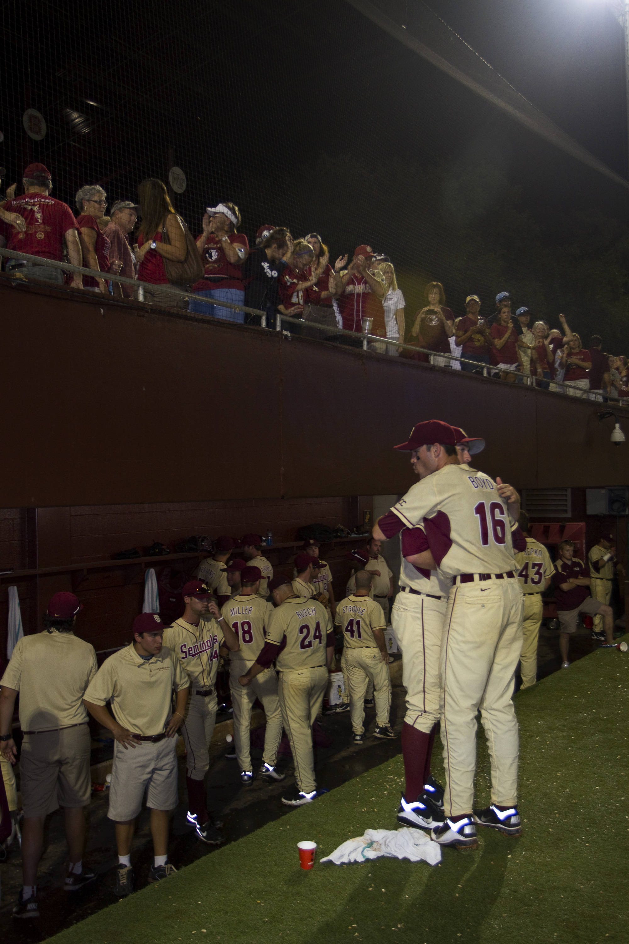 Seminole fans show support while players console each other.