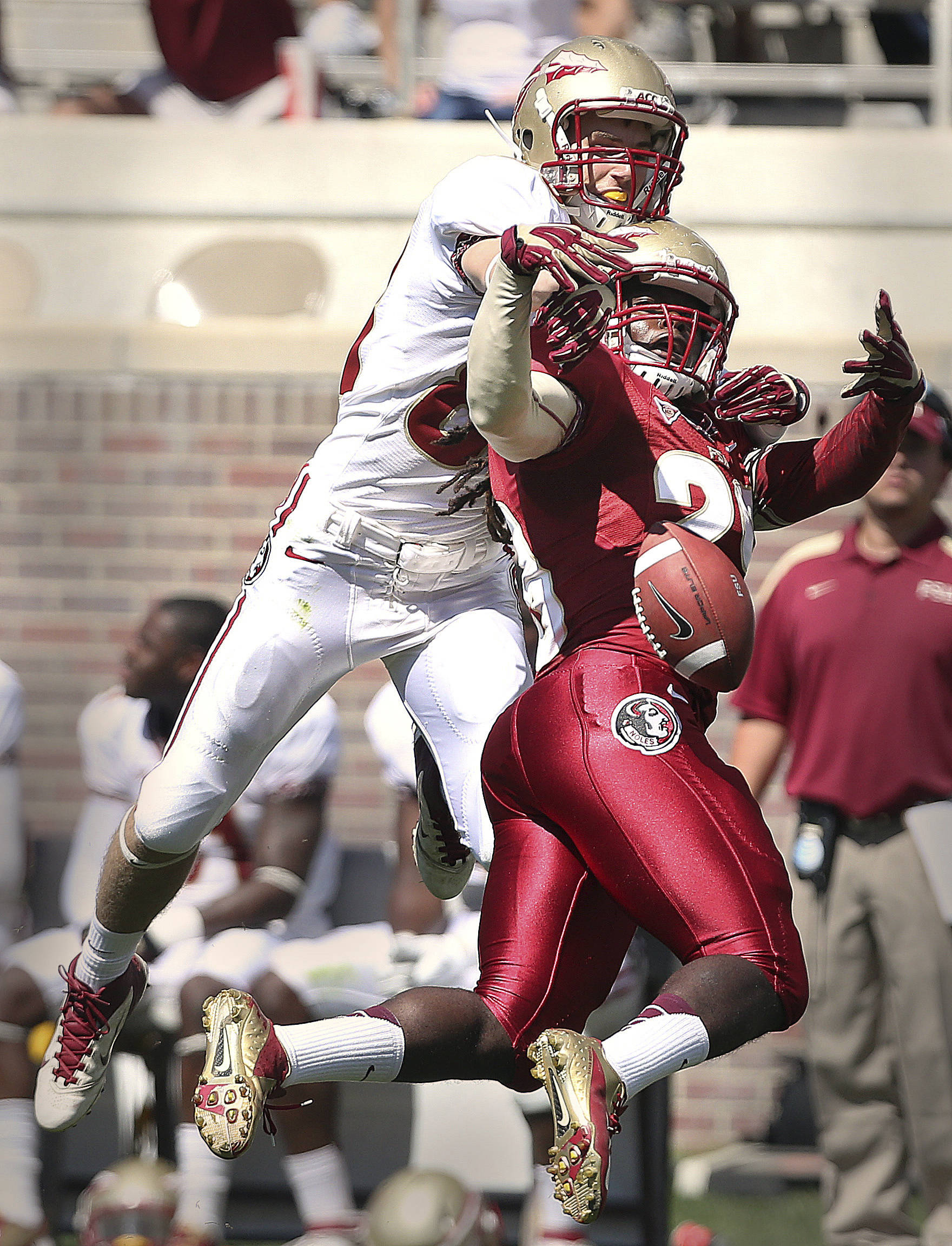Florida State receiver Jeren Kowalewski, left, battles defensive back Donovan Todd for a pass on Saturday. The defense won this battle inside of Doak Campbell Stadium on April 13, 2013. An estimated 25 thousand people came out to get a first look at their beloved Seminoles. (AP Photo/Tallahassee Democrat, Mike Ewen)