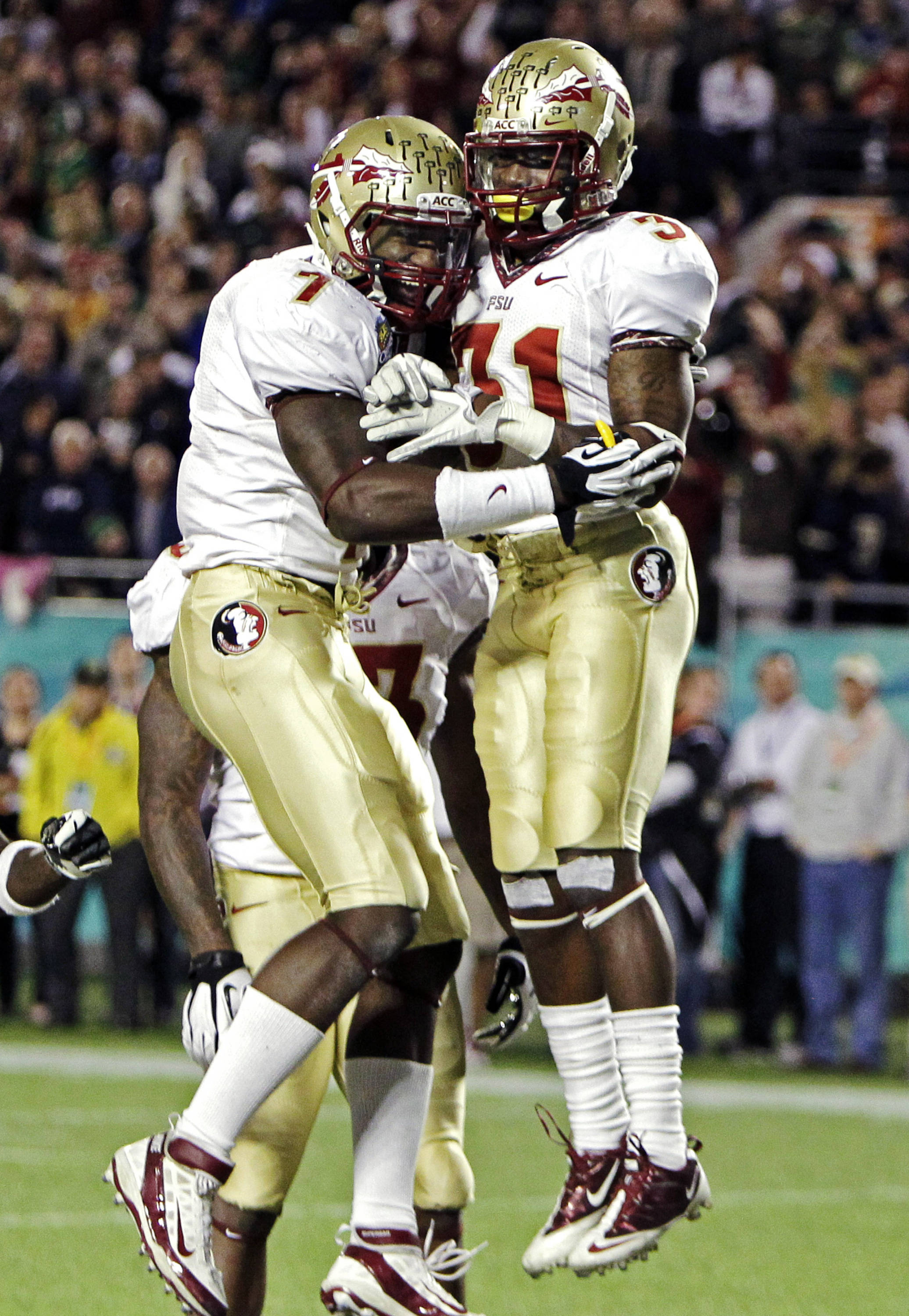 Florida State defensive back Terrence Brooks (31) celebrates with linebacker Christian Jones (7) after intercepting a pass in the end zone to stop a Notre Dame drive during the final minutes of the Champs Sports Bowl. (AP Photo/John Raoux)
