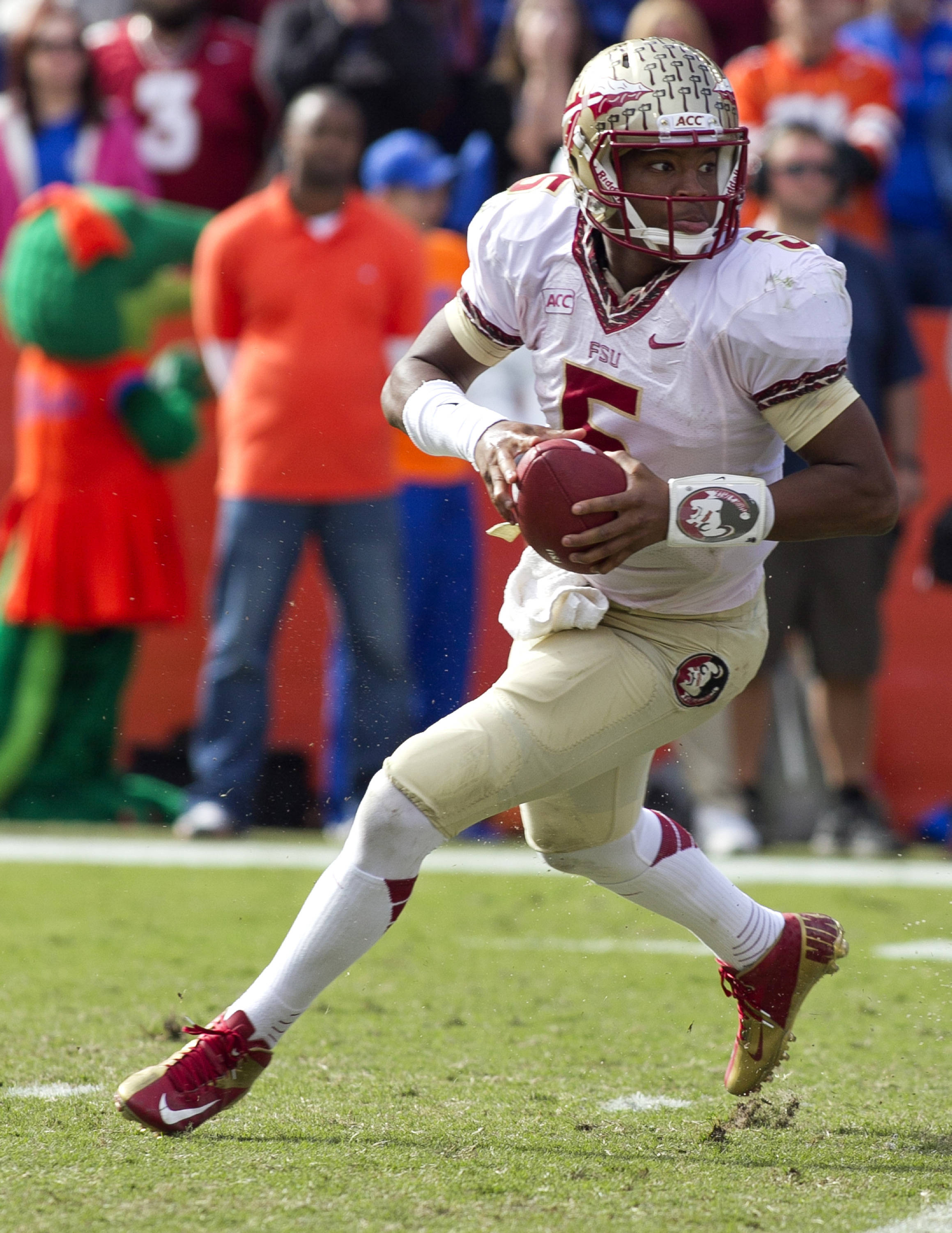 Jameis Winston (5) on a roll out, FSU vs Florida, 11-30-13,  (Photo by Steve Musco)