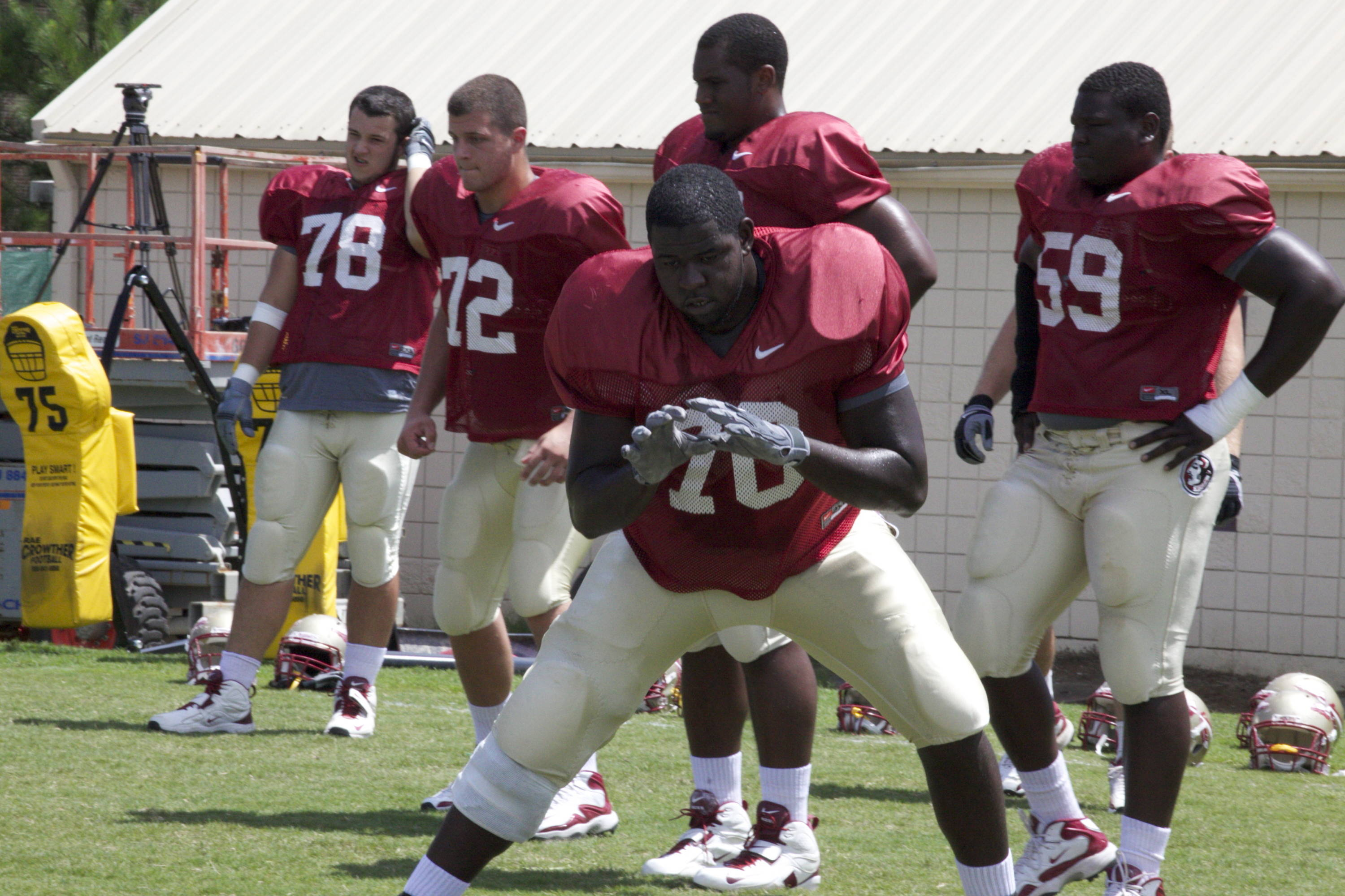 Antwane Greenlee (70) in a blocking drill