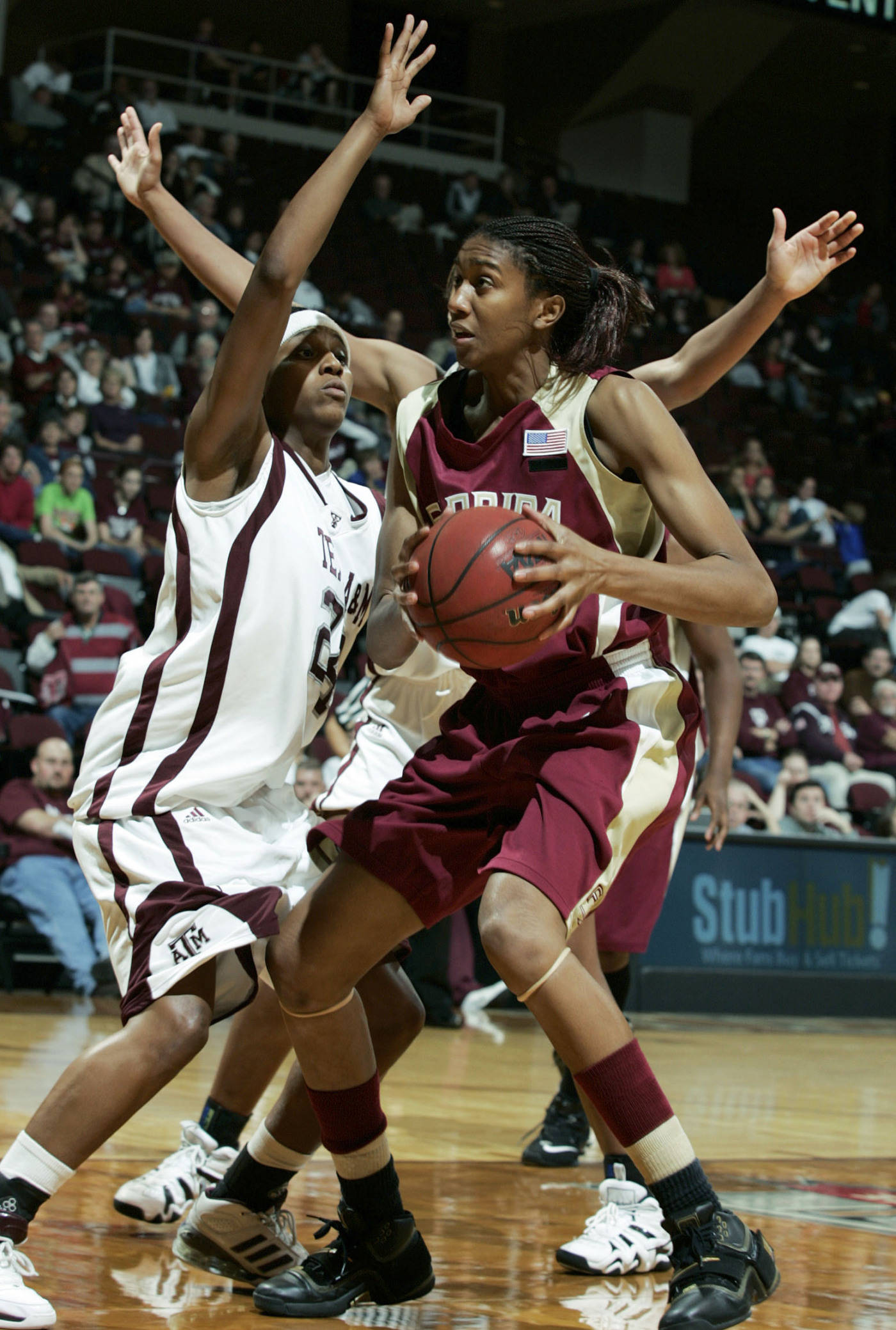 Florida State's Tanae Davis-Cain, right, is guarded by Texas A&M's Patrice Reado during the second half of a college basketball game, on Thursday, Dec. 6, 2007, in College Station, Texas. Texas A&M defeated Florida State 81-67. (AP Photo/Paul Zoeller)