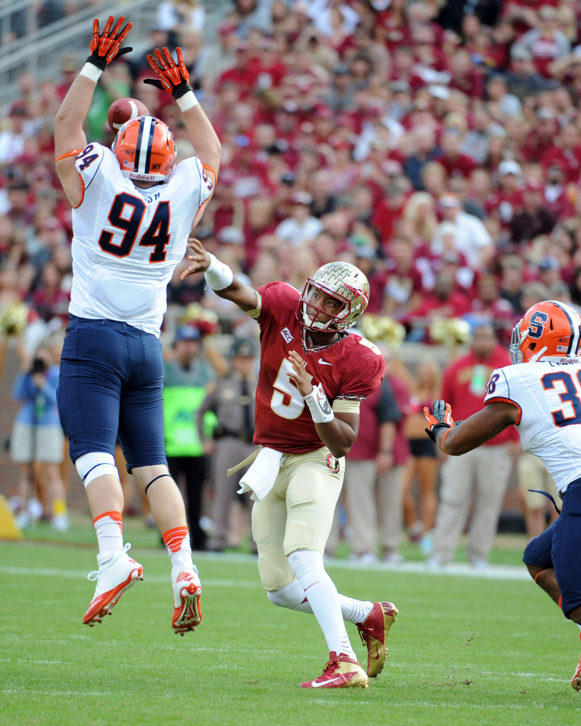 Jameis Winston (5) throws the ball over Syracuse Orange defensive end Robert Welsh (94) during the first half. Mandatory Credit: Melina Vastola-USA TODAY Sports