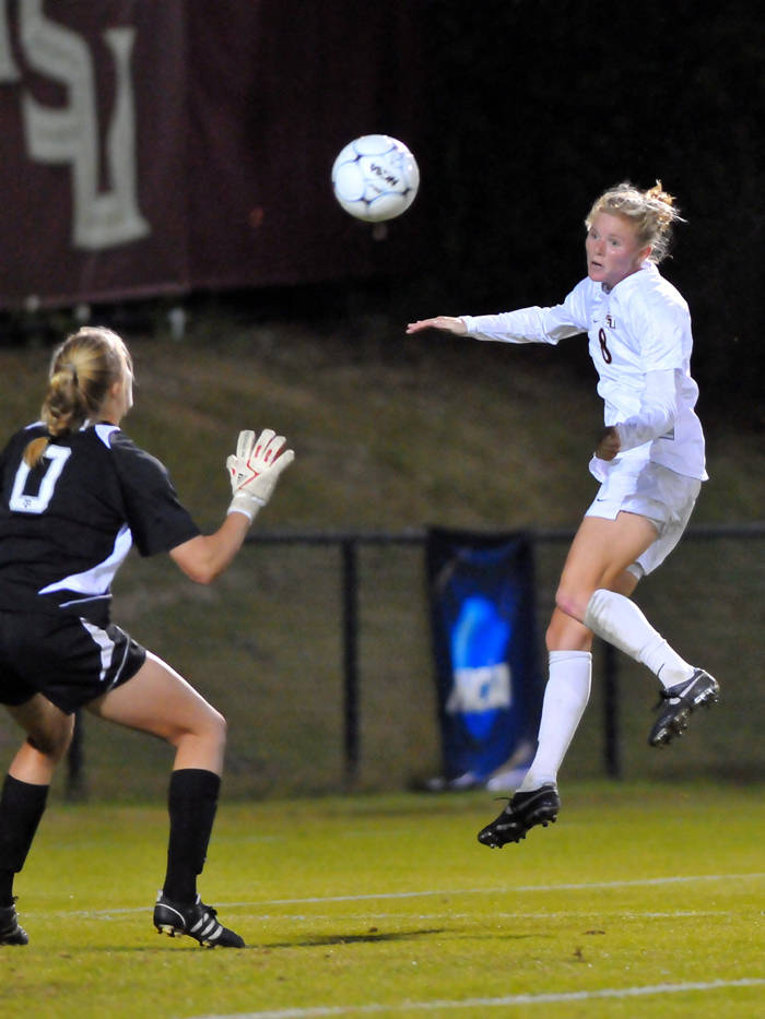 Lauren Switzer connects on a header to tie the game at 1-1.