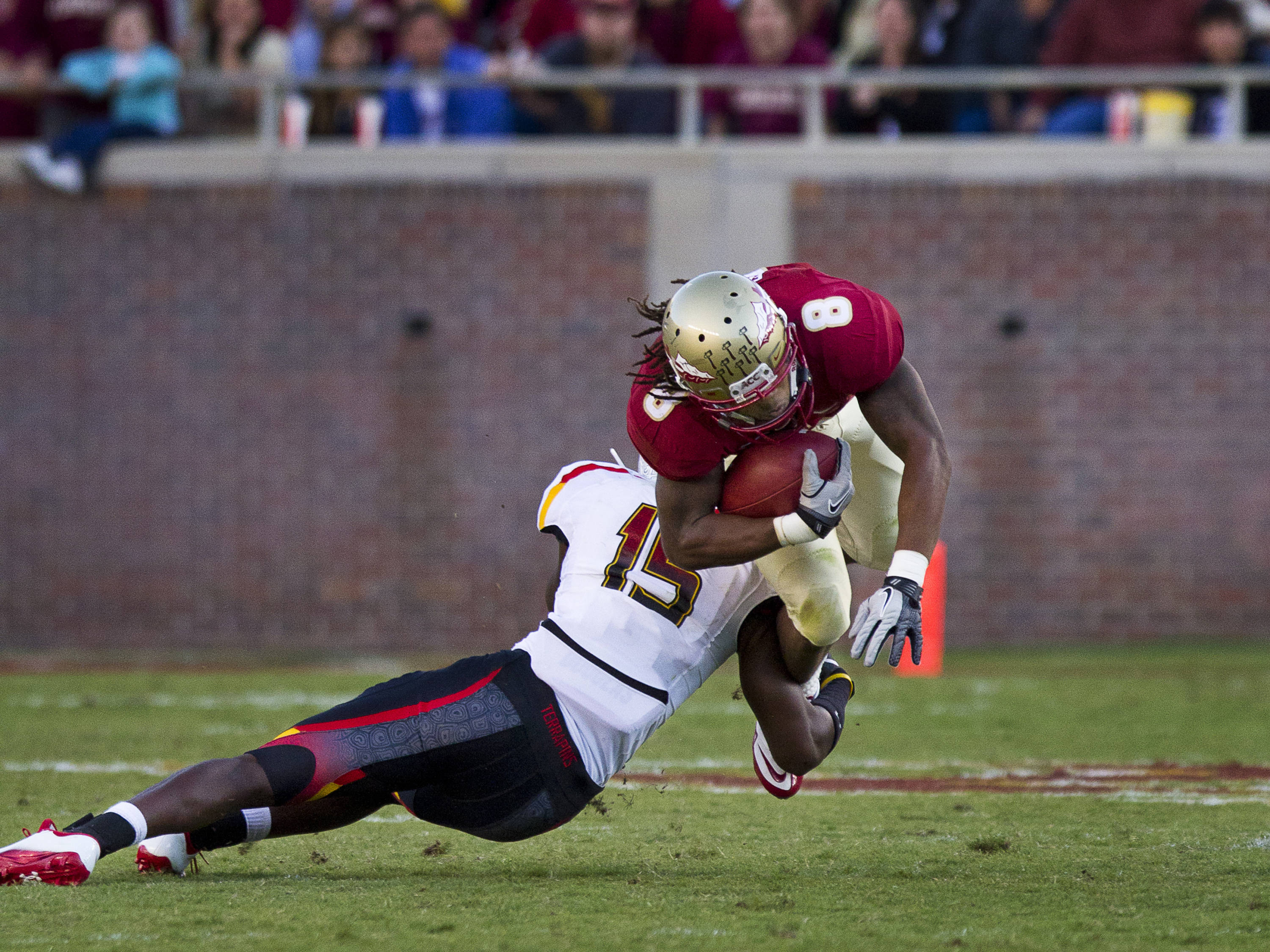 Timmy Jernigan (8) carries the ball down field during the football game against Maryland in Tallahassee, Florida on October 22, 2011.