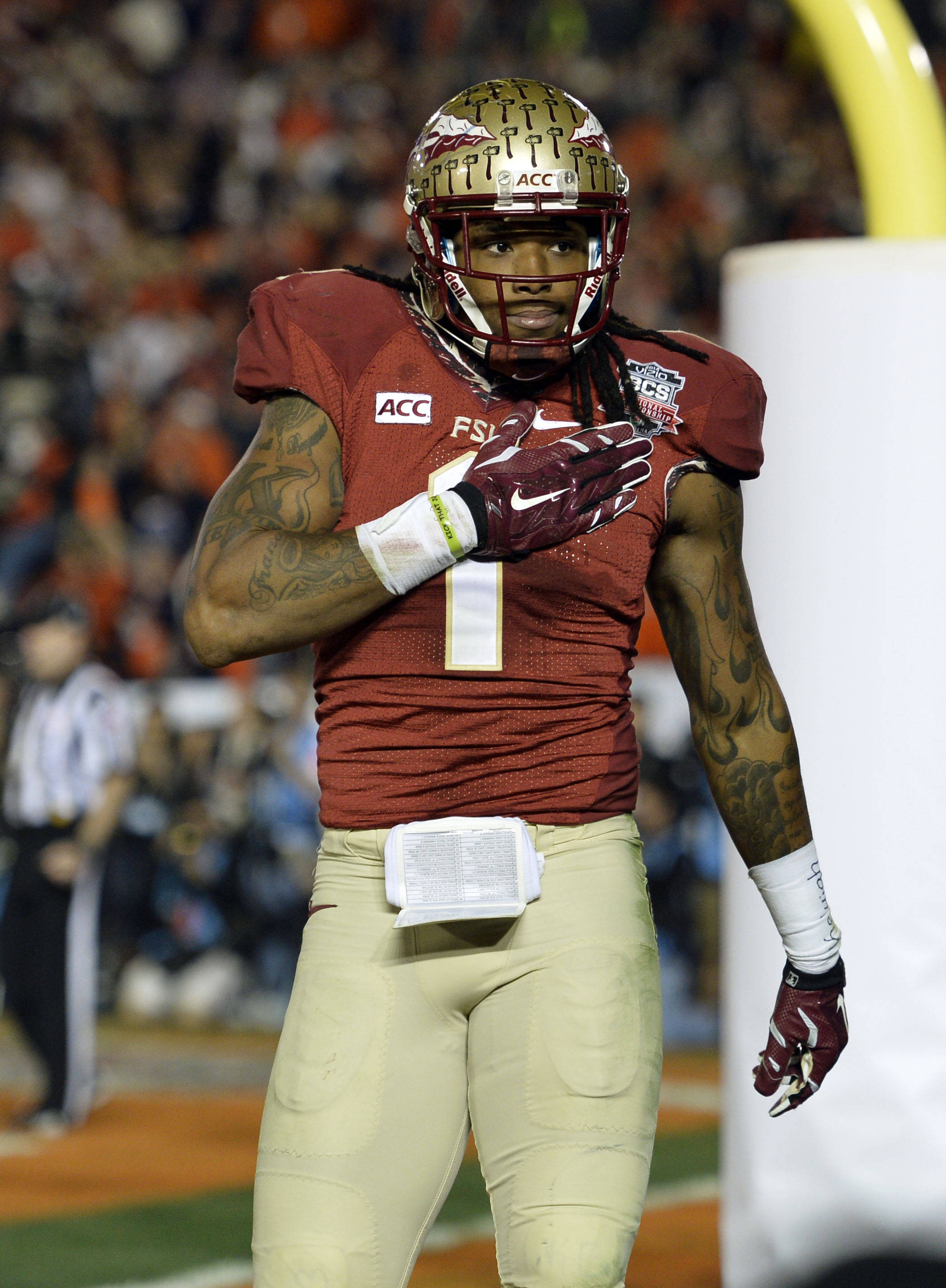 Jan 6, 2014; Pasadena, CA, USA; Florida State Seminoles wide receiver Kelvin Benjamin (1) celebrates after scoring a touchdown against the Auburn Tigers during the second half of the 2014 BCS National Championship game at the Rose Bowl.  Mandatory Credit: Robert Hanashiro-USA TODAY Sports