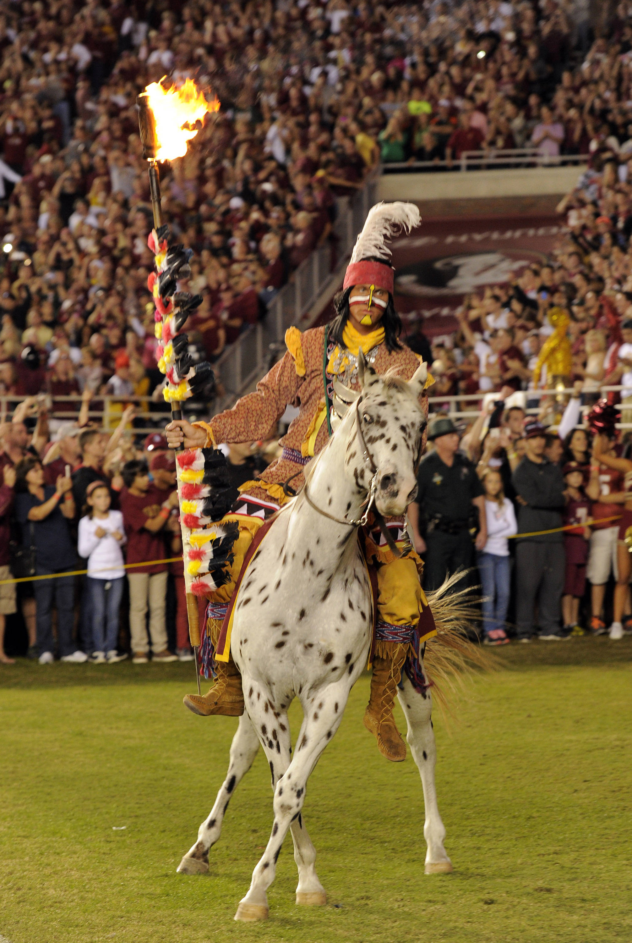 Florida State Seminoles mascot Chief Osceola carries the flaming spear  before the start of their game against the Miami Hurricanes at Doak Campbell Stadium. Mandatory Credit: John David Mercer-USA TODAY Sports