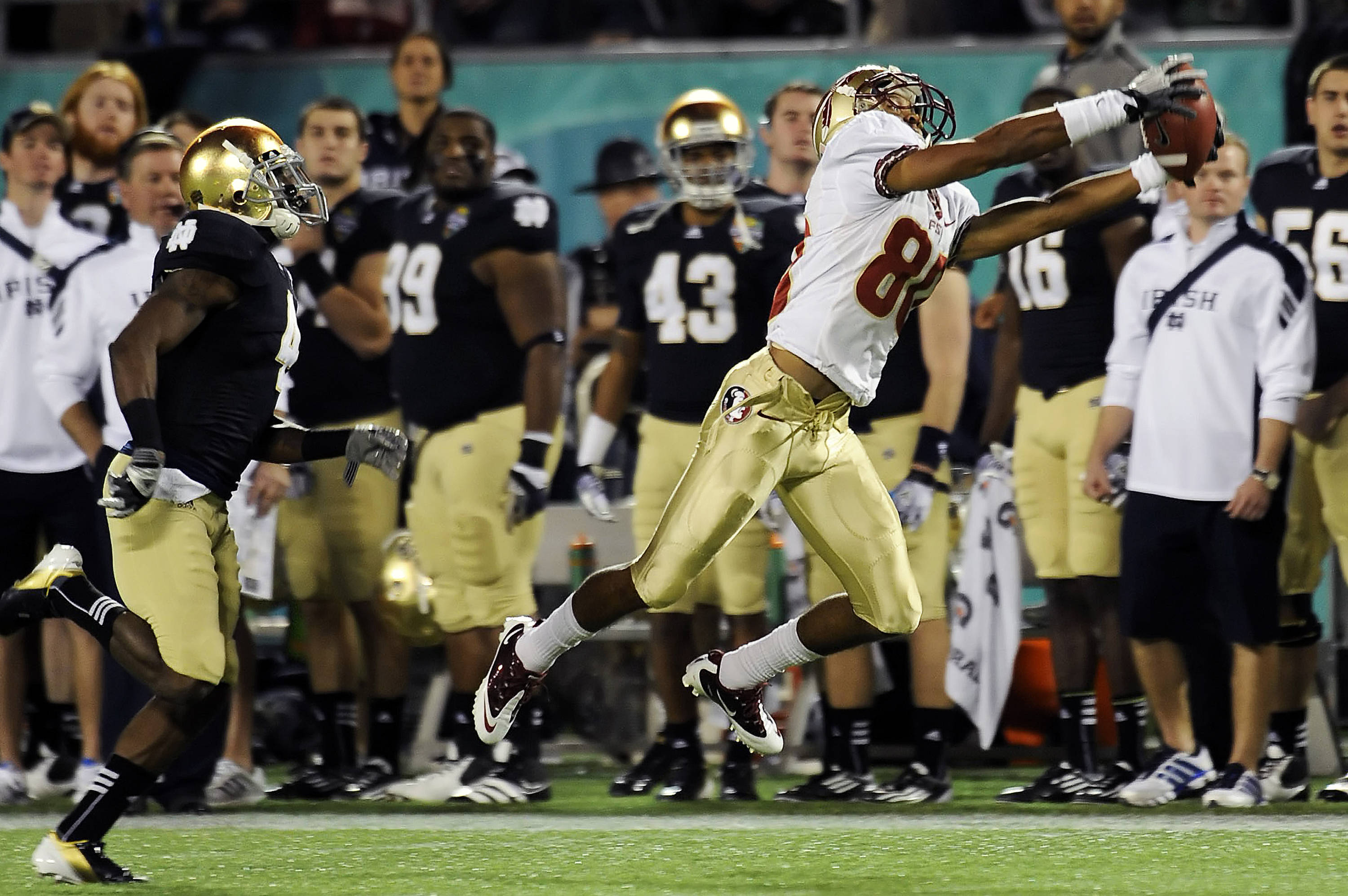 MVP Rashad Greene (80) makes a leaping catch down the sidelines