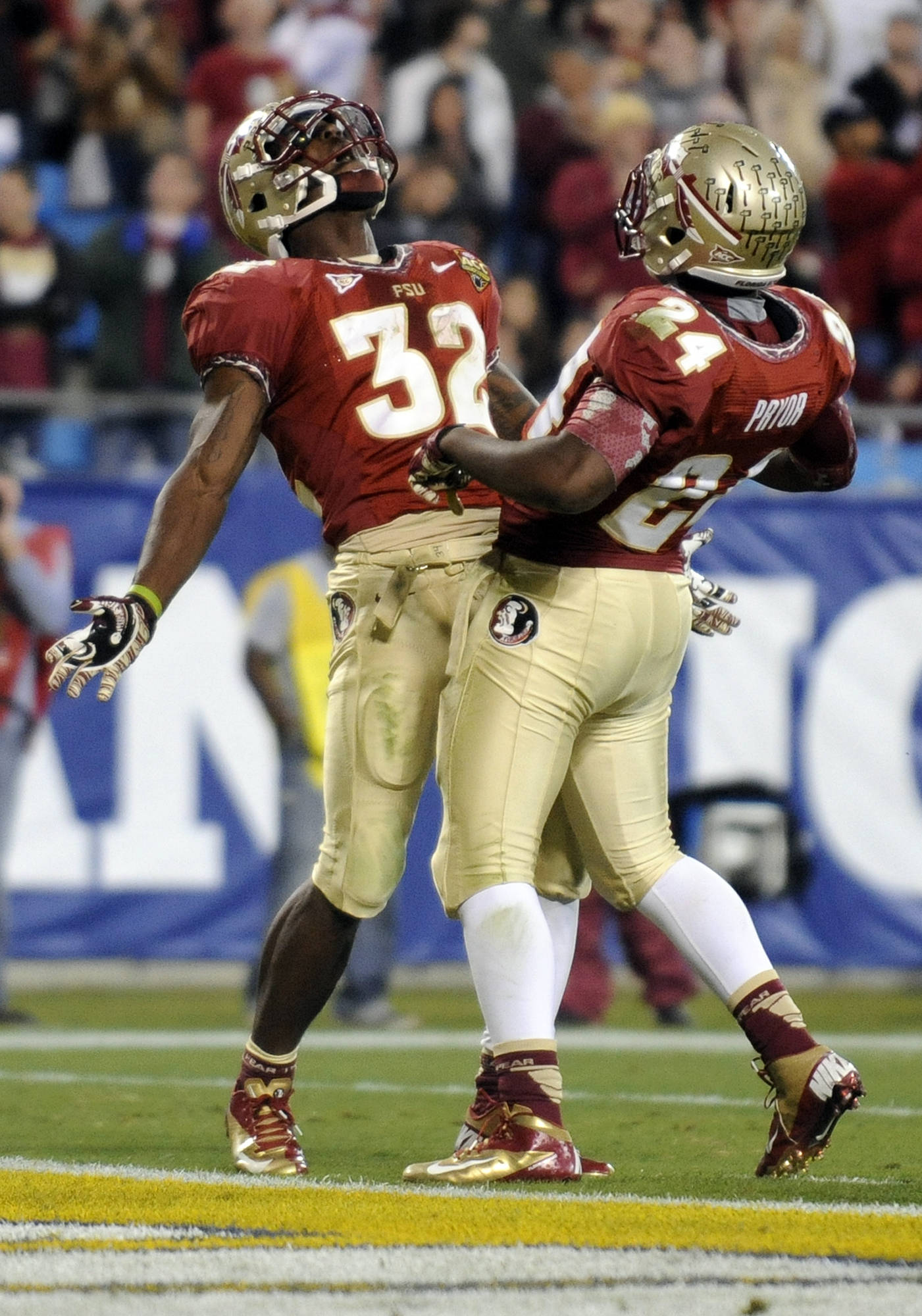 Florida State's James Wilder Jr. (32) celebrates his touchdown run with teammate Lonnie Pryor (24) during the first half. (AP Photo/Mike McCarn)