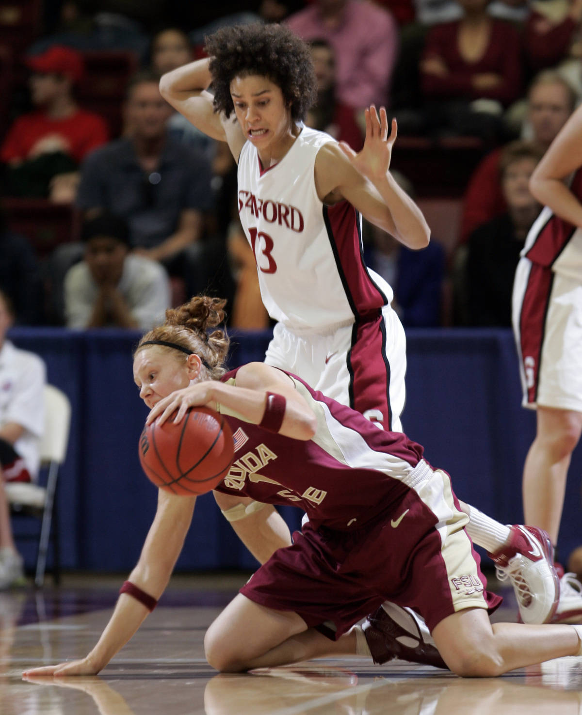 Florida State guard Mara Freshour retains possession of the ball while on her knees in front of Stanford guard Cissy Pierce (13) in the first half of their second-round game in the NCAA women's basketball tournament in Stanford, Calif., Monday, March 19, 2007. (AP Photo/Paul Sakuma)
