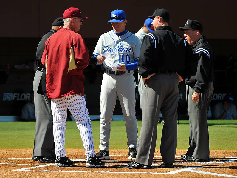 Florida State head coach Mike Martin and Georgia State head coach Greg Frady meet with the umpires before the start of Saturday's game.