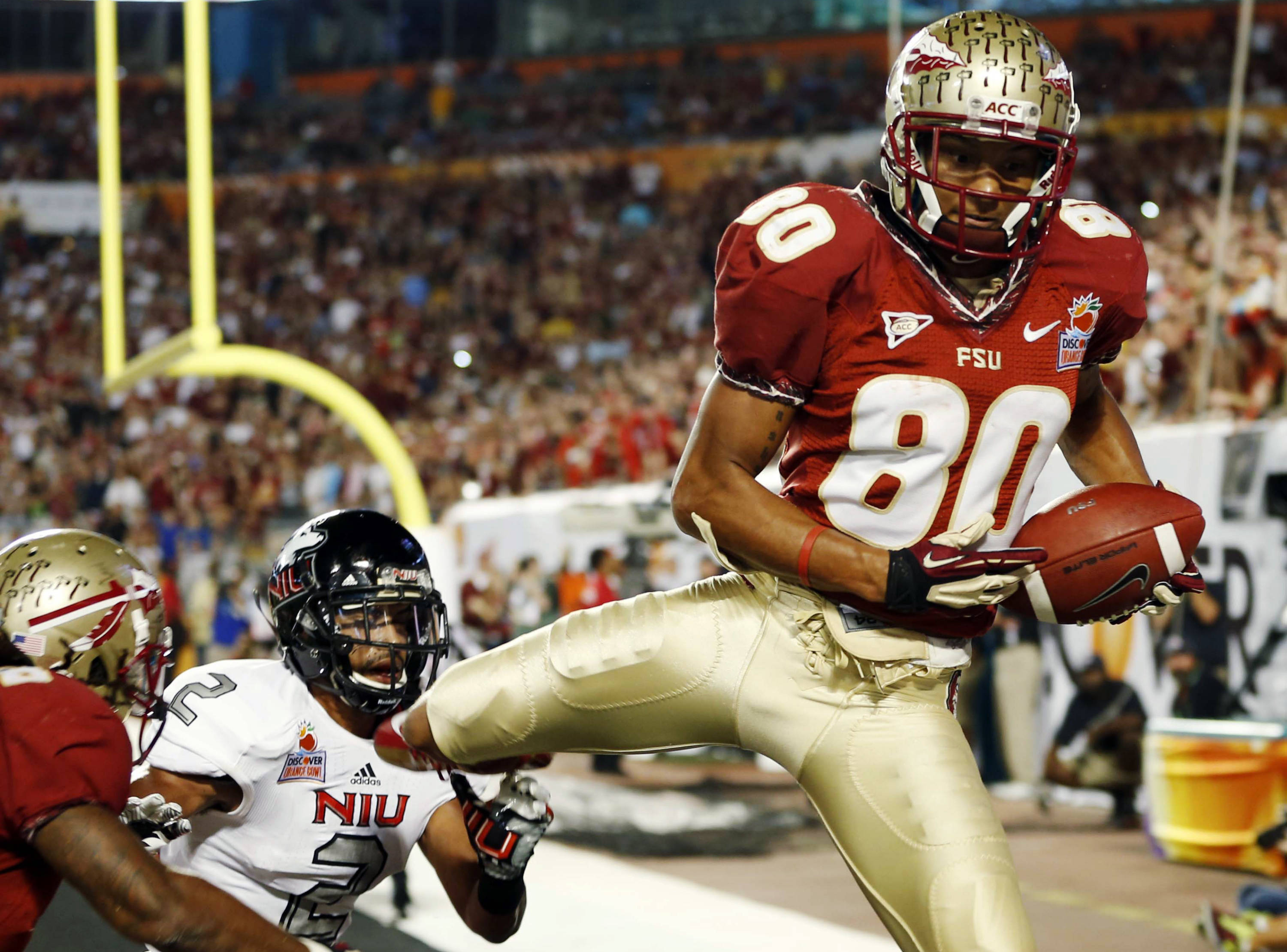 Florida State wide receiver Rashad Greene (80) pulls in a touchdown in the end zone during the first half of the Orange Bowl NCAA college football game against Northern Illinois, Tuesday, Jan. 1, 2013, in Miami. (AP Photo/Alan Diaz)