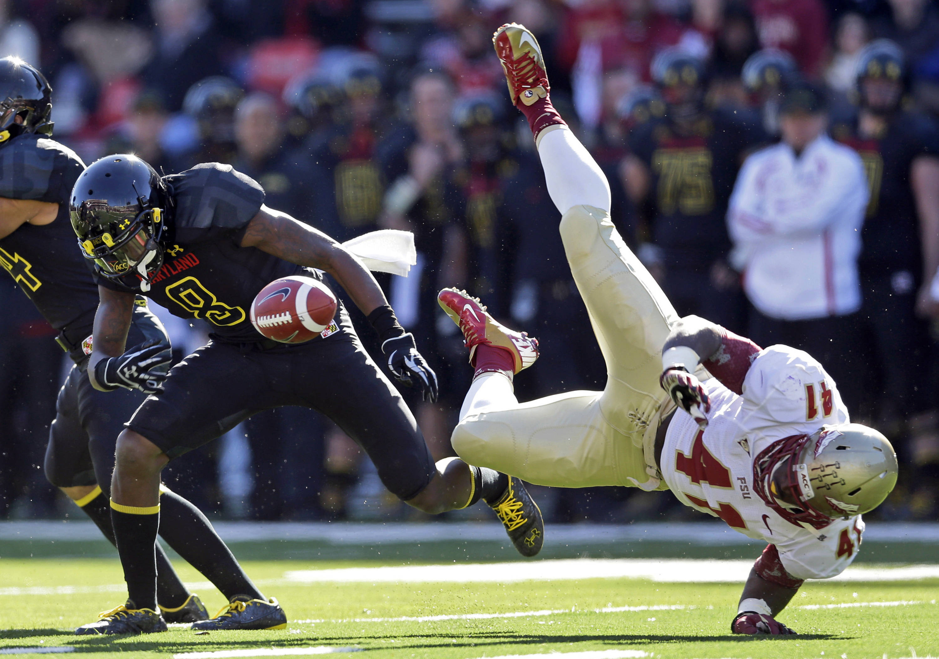 Maryland's Levern Jacobs, left, fumbles the ball after being hit by fullback Chad Abram on a kickoff return during the first half of an NCAA college football game in College Park, Md., Saturday, Nov. 17, 2012. Florida State recovered the ball on the play. (AP Photo/Patrick Semansky)