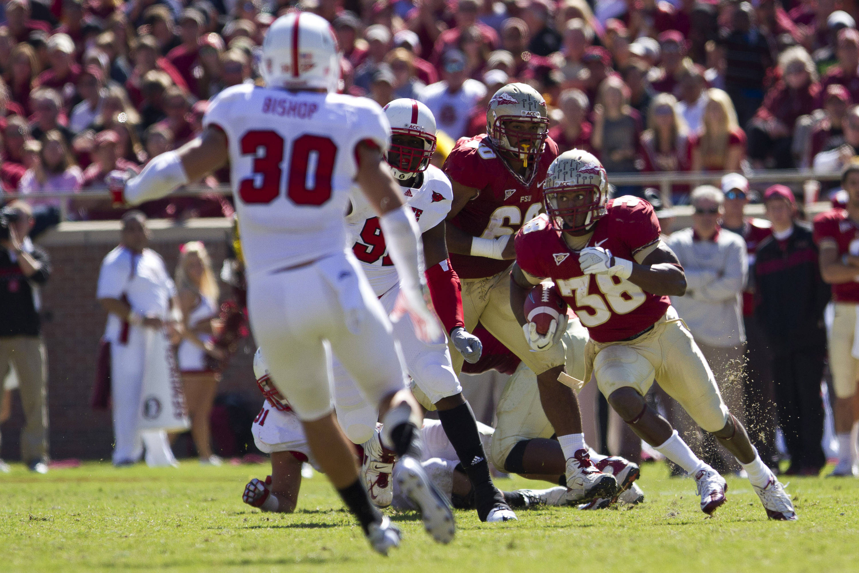Jermaine Thomas (38) carries the ball down the field during the football game against NC State on October 29, 2011.