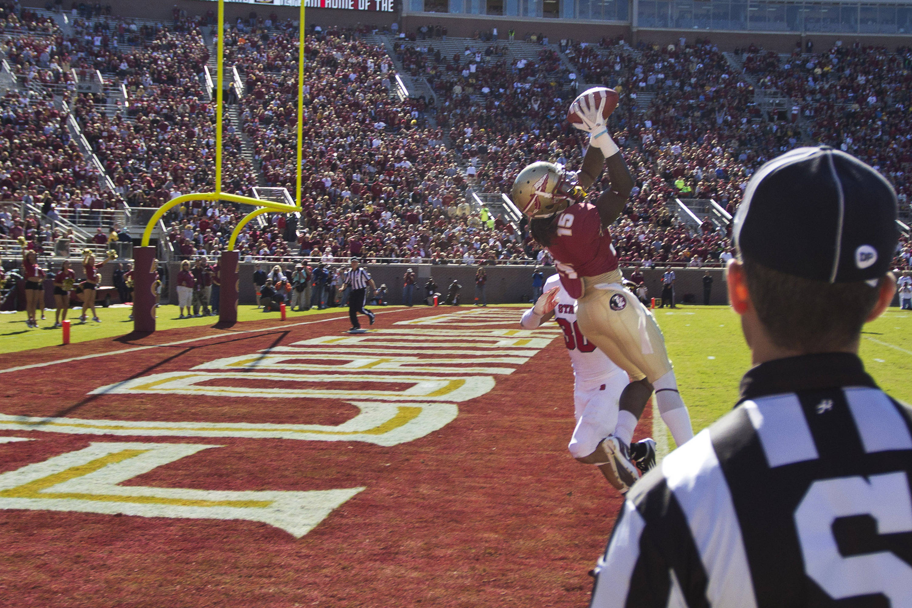 Greg Dent (15) catches a pass for a touchdown during the football game against NC State on October 29, 2011.