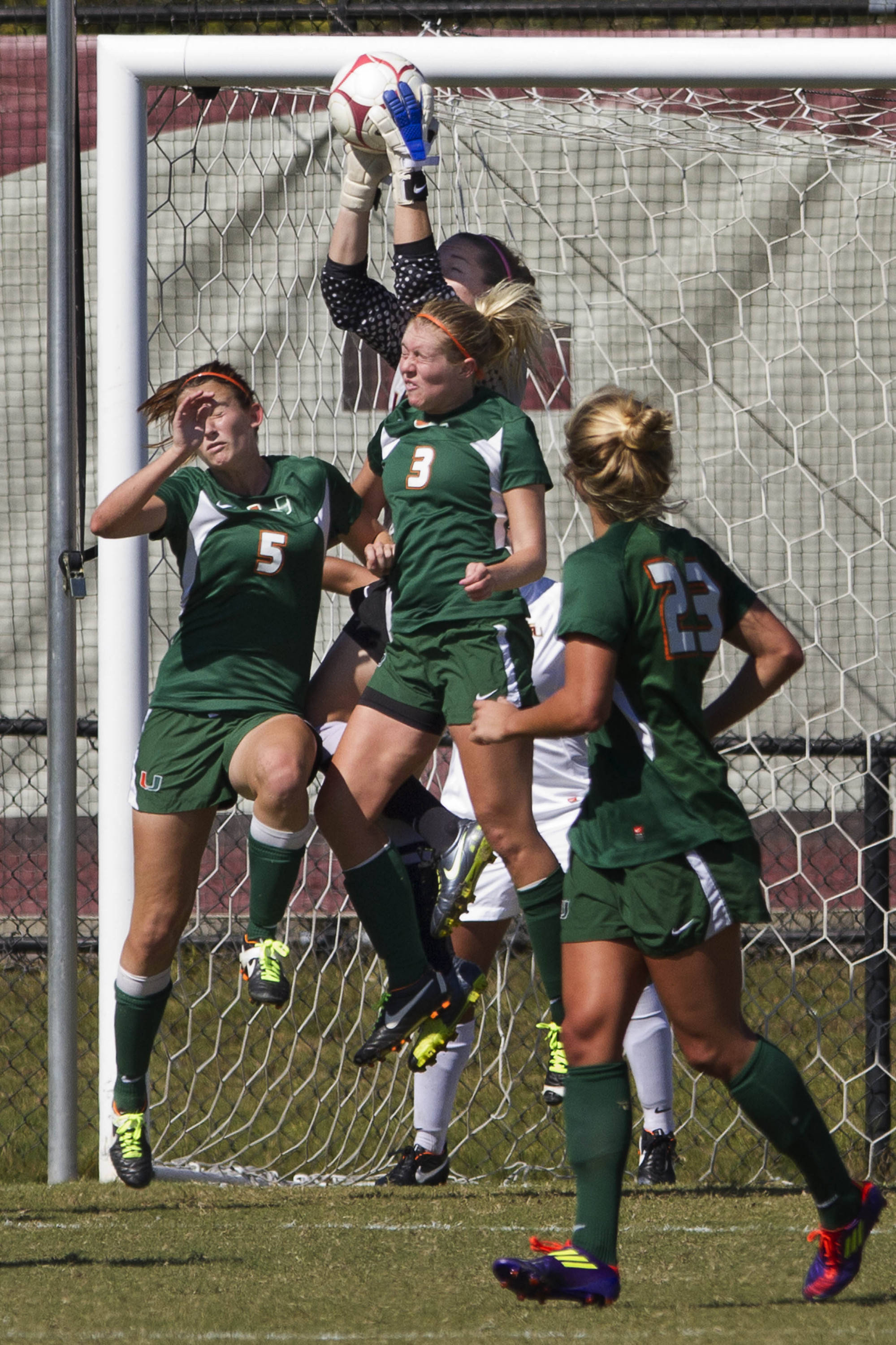 FSU Keeper Kelsey Wys (19) makes a save over the heads of Miami players.