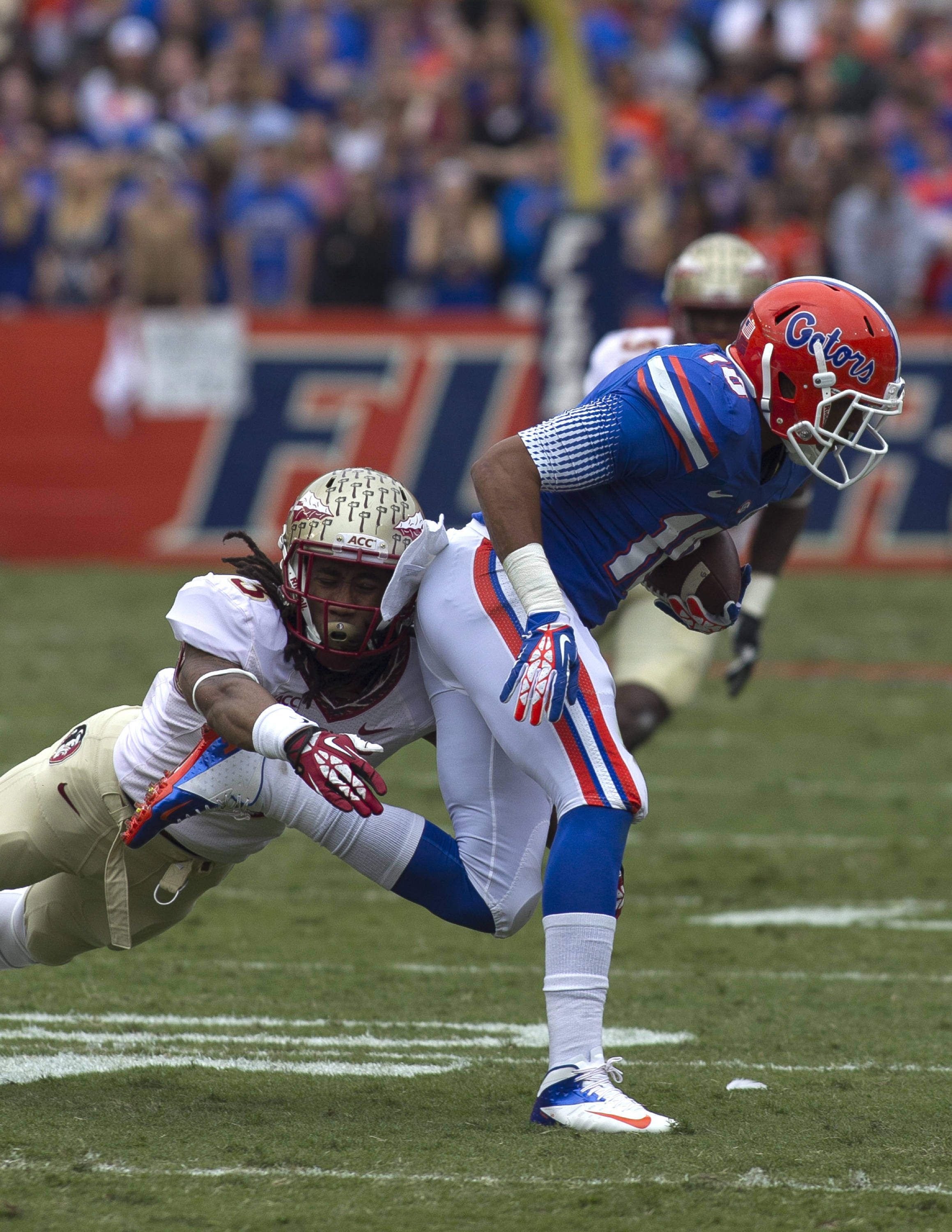 Ronald Darby (3) with a defensive stop, FSU vs Florida, 11-30-13,  (Photo by Steve Musco)