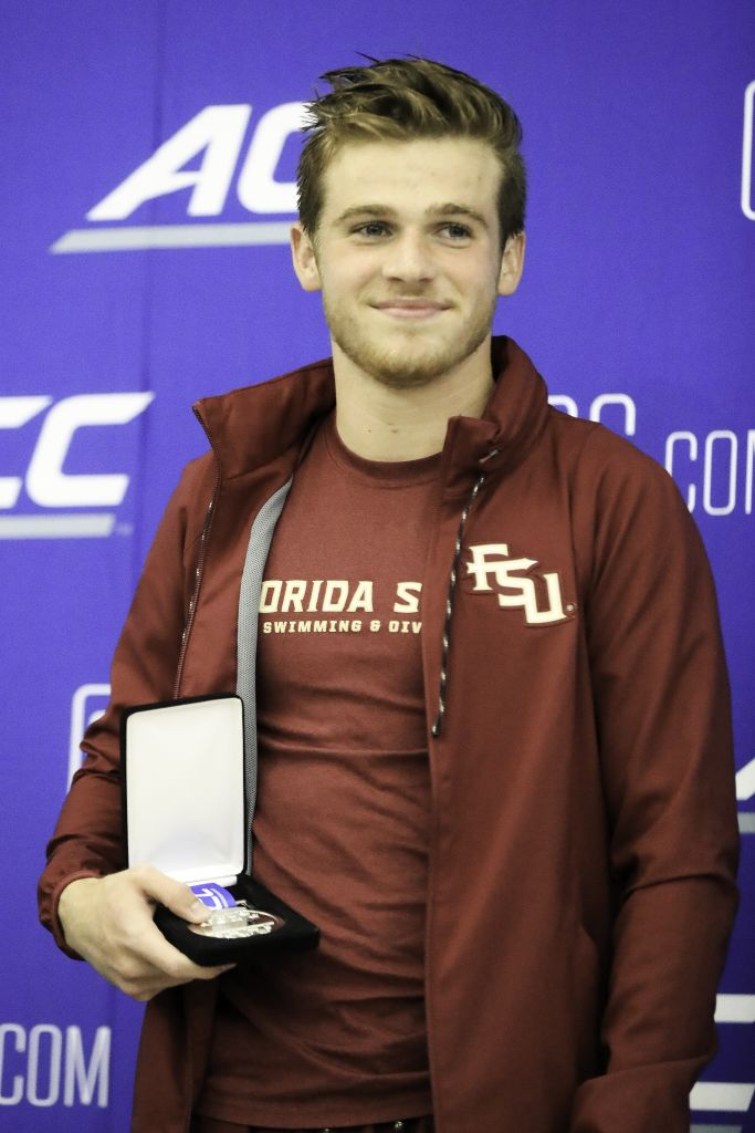 Joshua Davidson holds his silver medal from Men's 3M diving